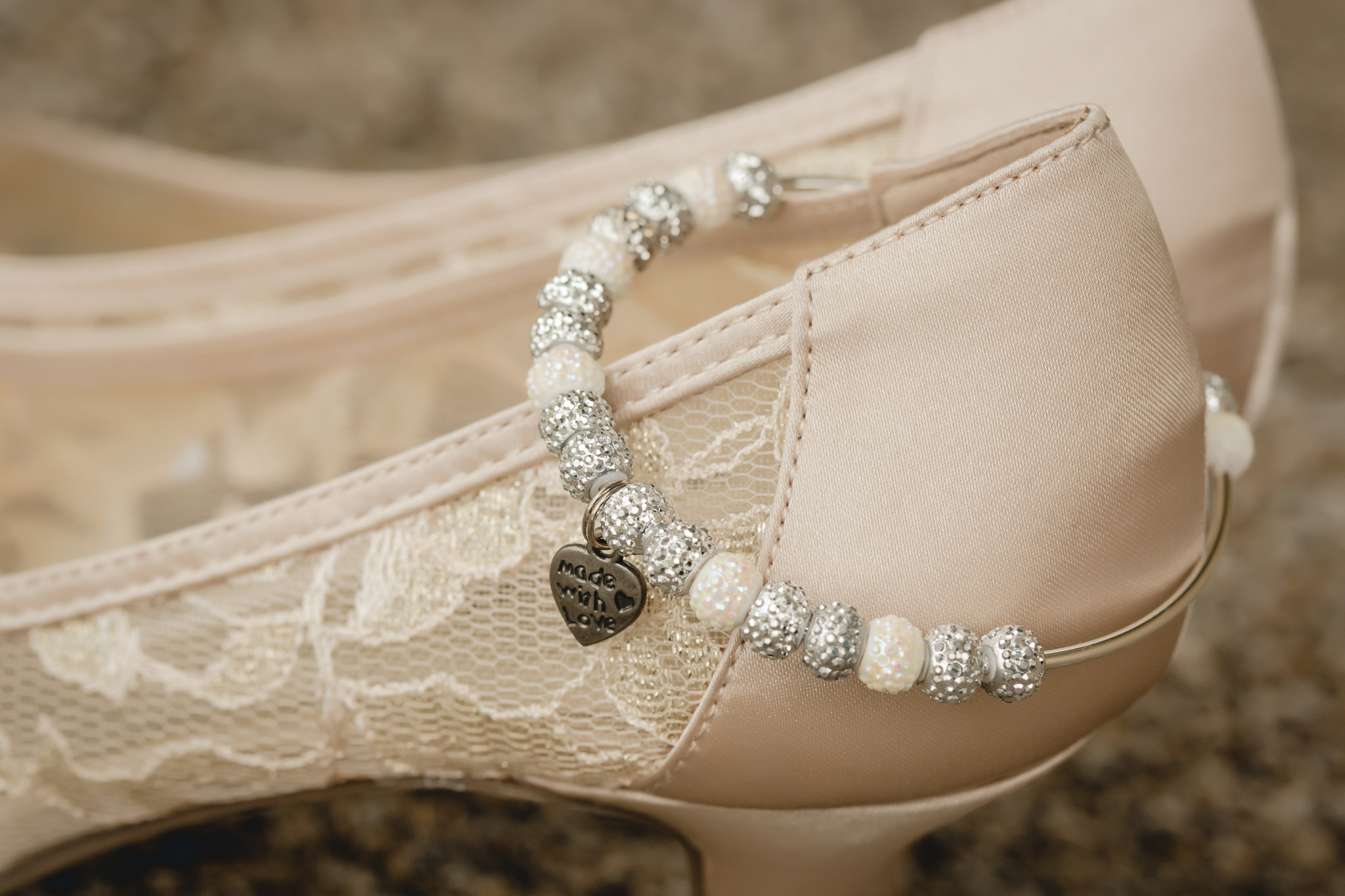 Personalized bracelet on wedding shoes at a spring wedding in Pittsburgh