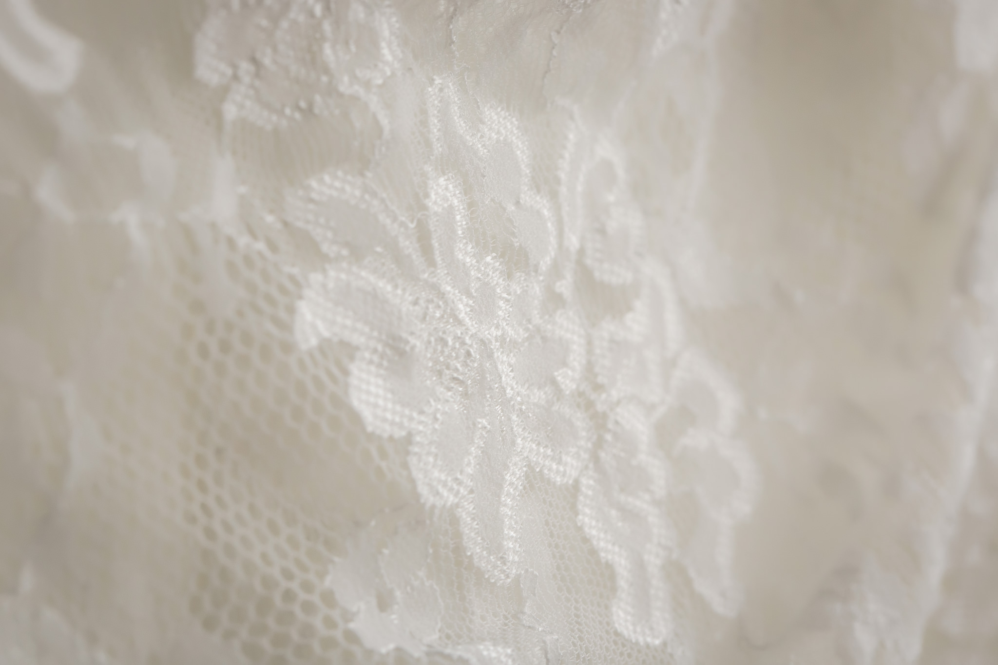 Lacey details of a wedding dress for an April wedding in Pittsburgh