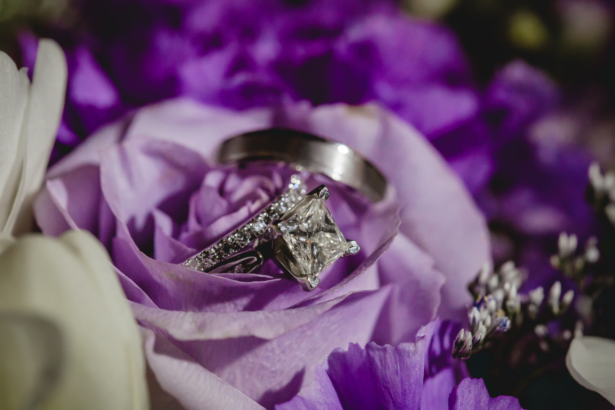 Wedding rings in a bouquet of flowers by Carrie Anne Powell Floral Designs