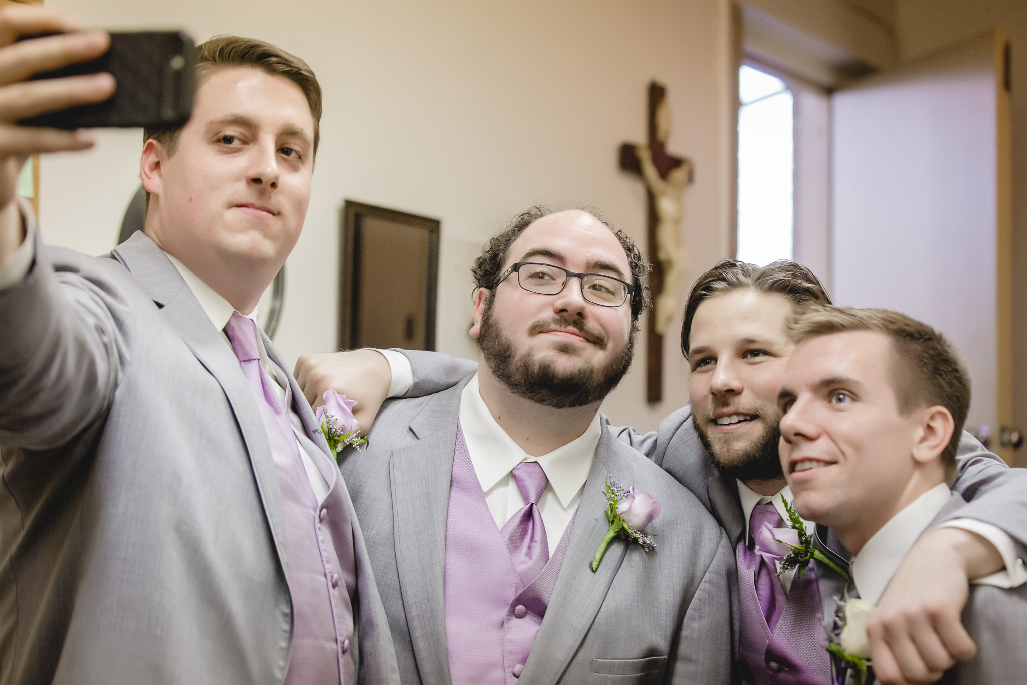 Groomsmen take a selfie at St. Malachy before wedding ceremony