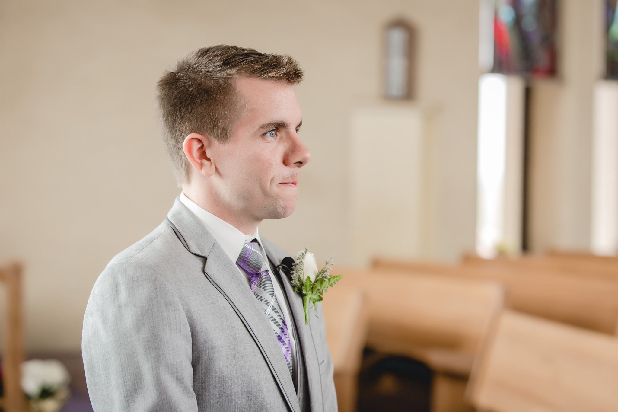 Groom sees his bride for the first time at St. Malachy Catholic Church