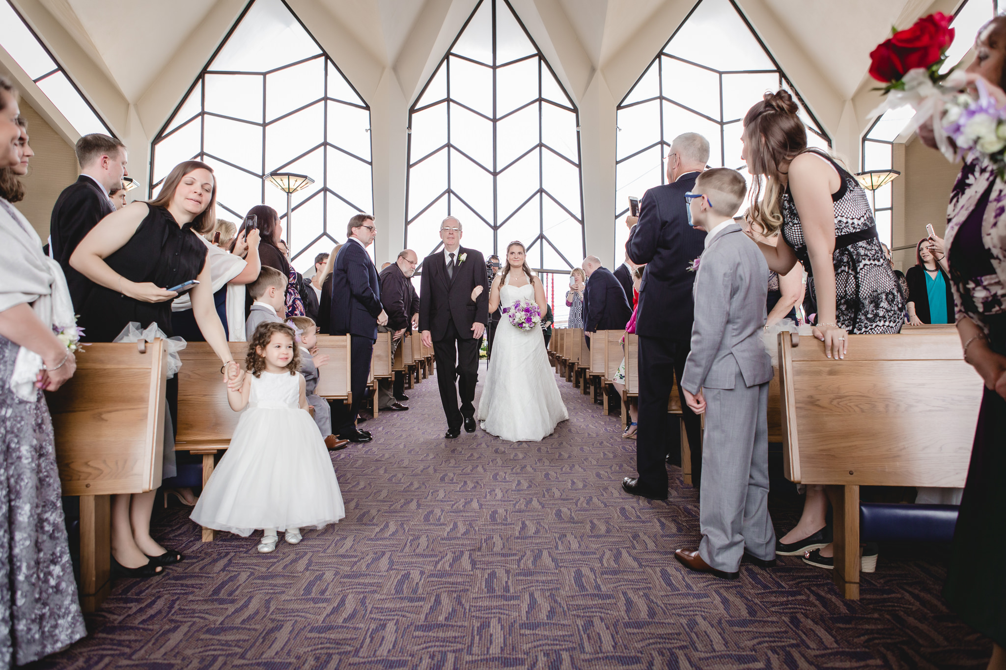 Bride walking down the aisle with her father at St. Malachy