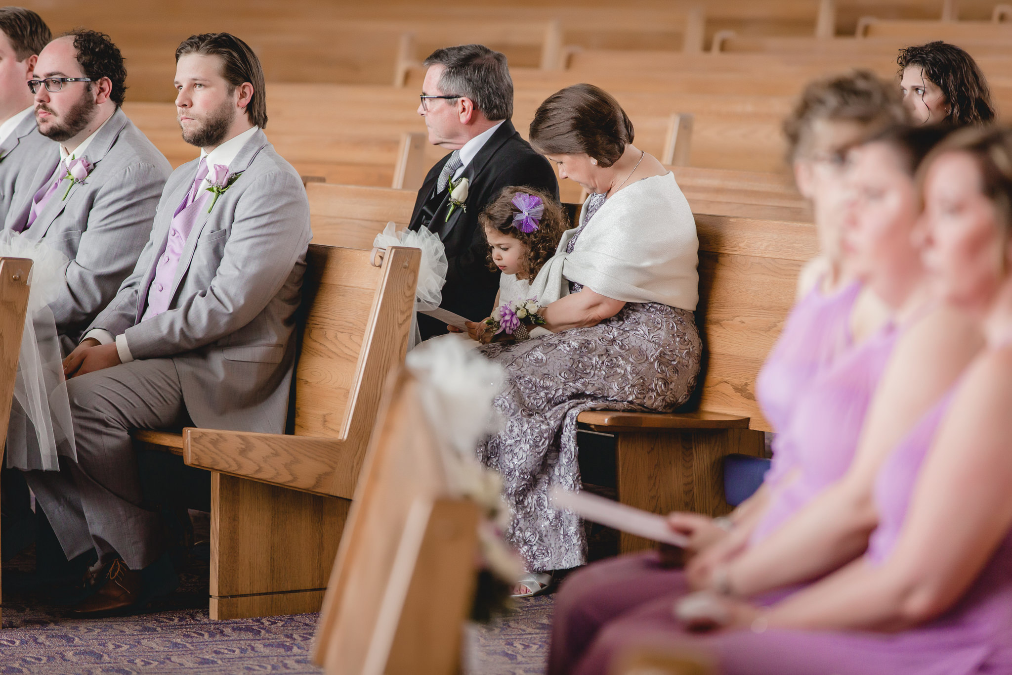 Parents of the groom with their granddaughter