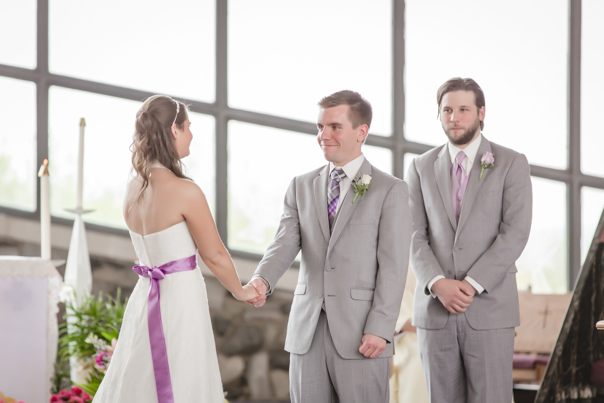 Bride and groom exchange vows at wedding ceremony at St. Malachy Catholic Church