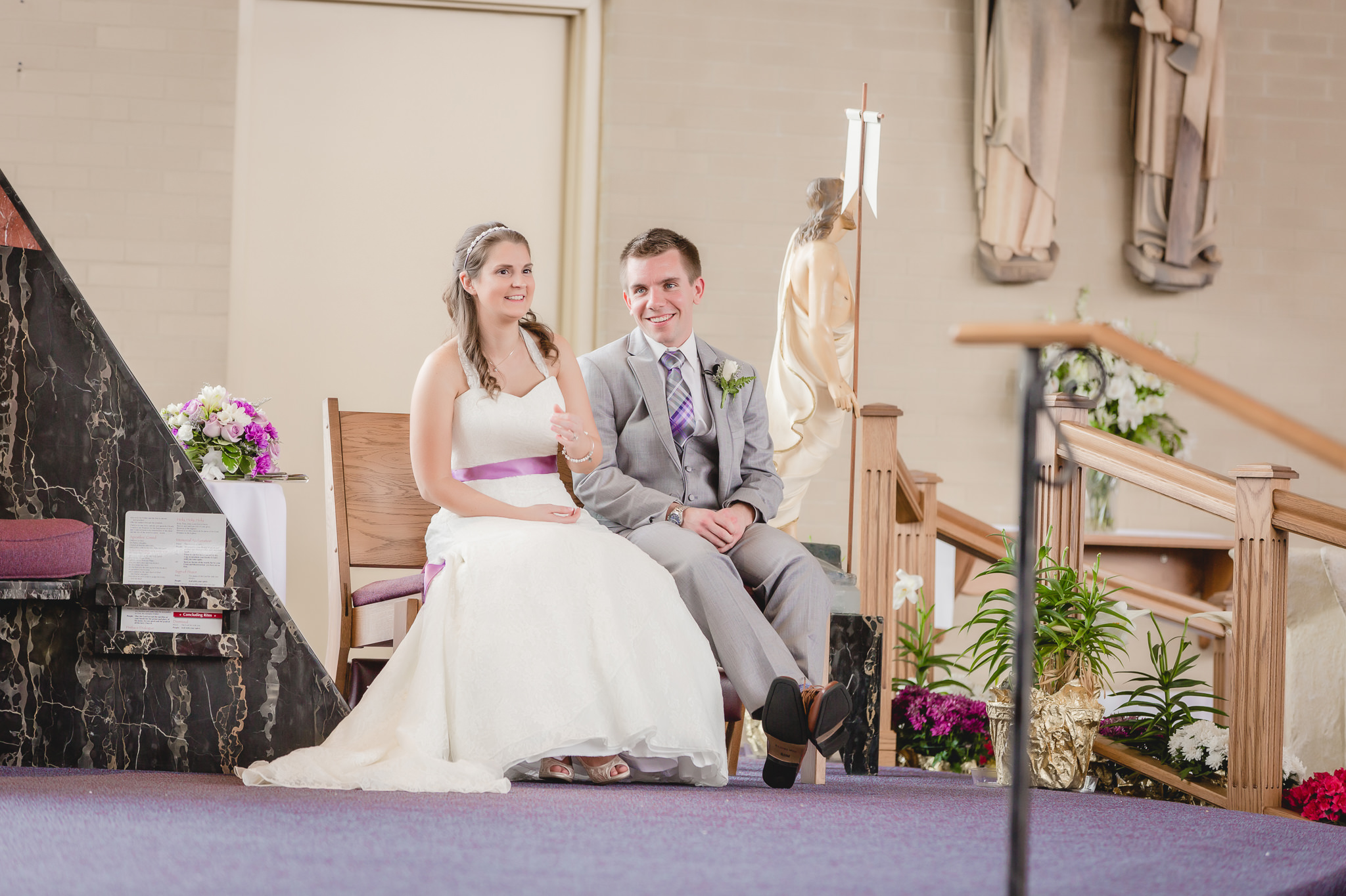 Bride & groom laugh during their St. Malachy wedding ceremony