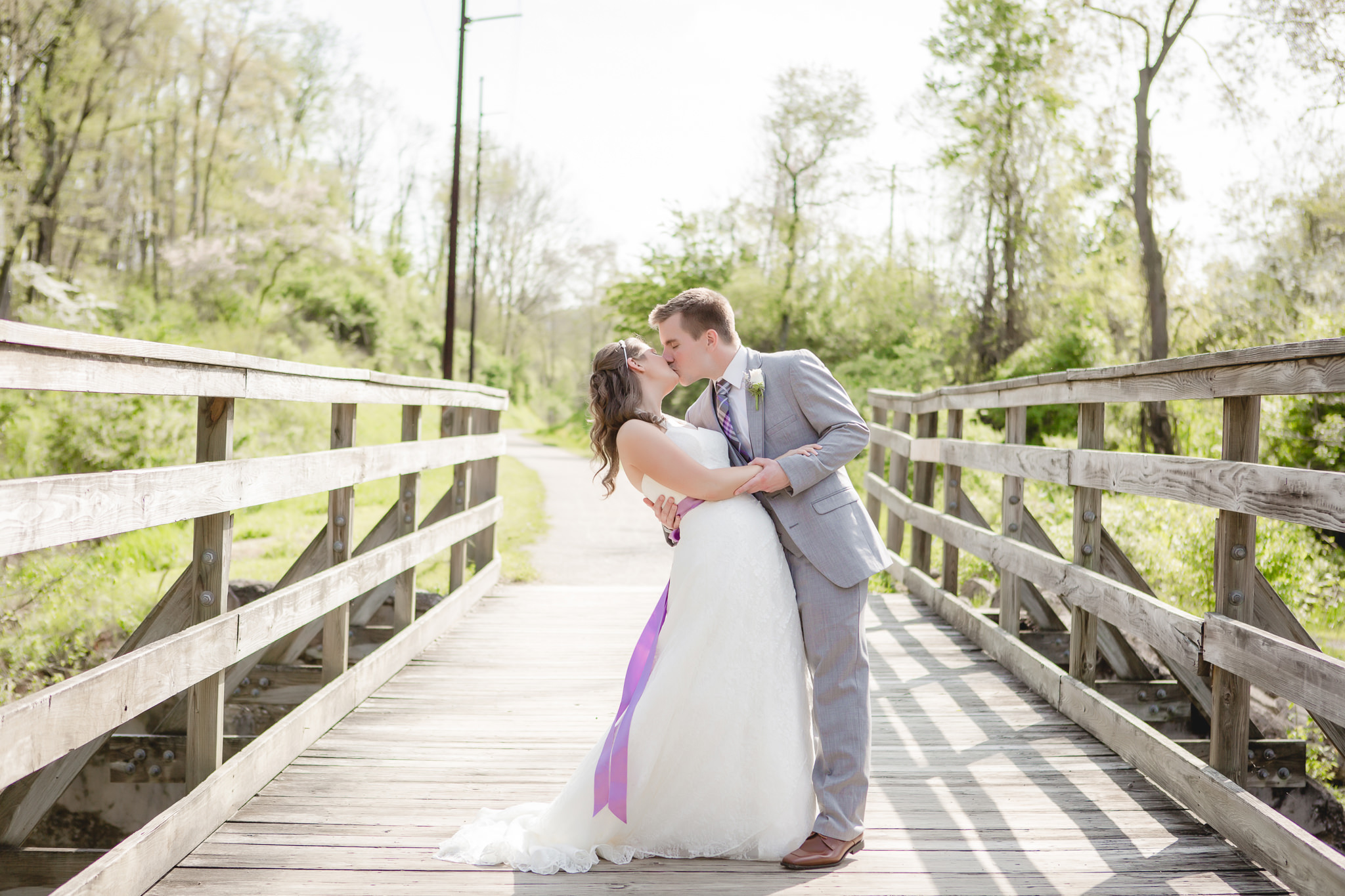 Groom dips his bride on the Montour Trail in Robinson Township