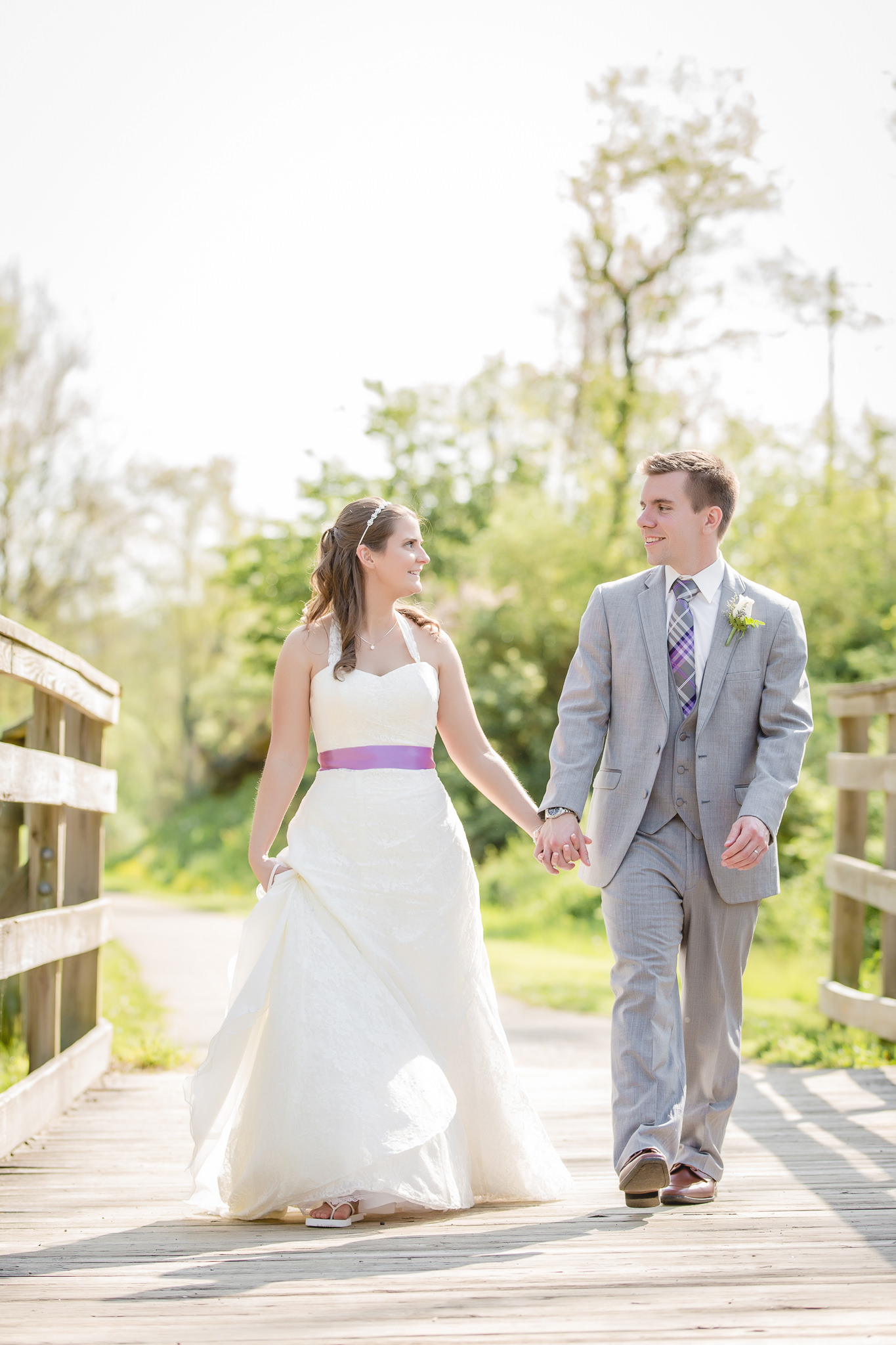 Bride & groom walking on the Montour Trail before their wedding reception