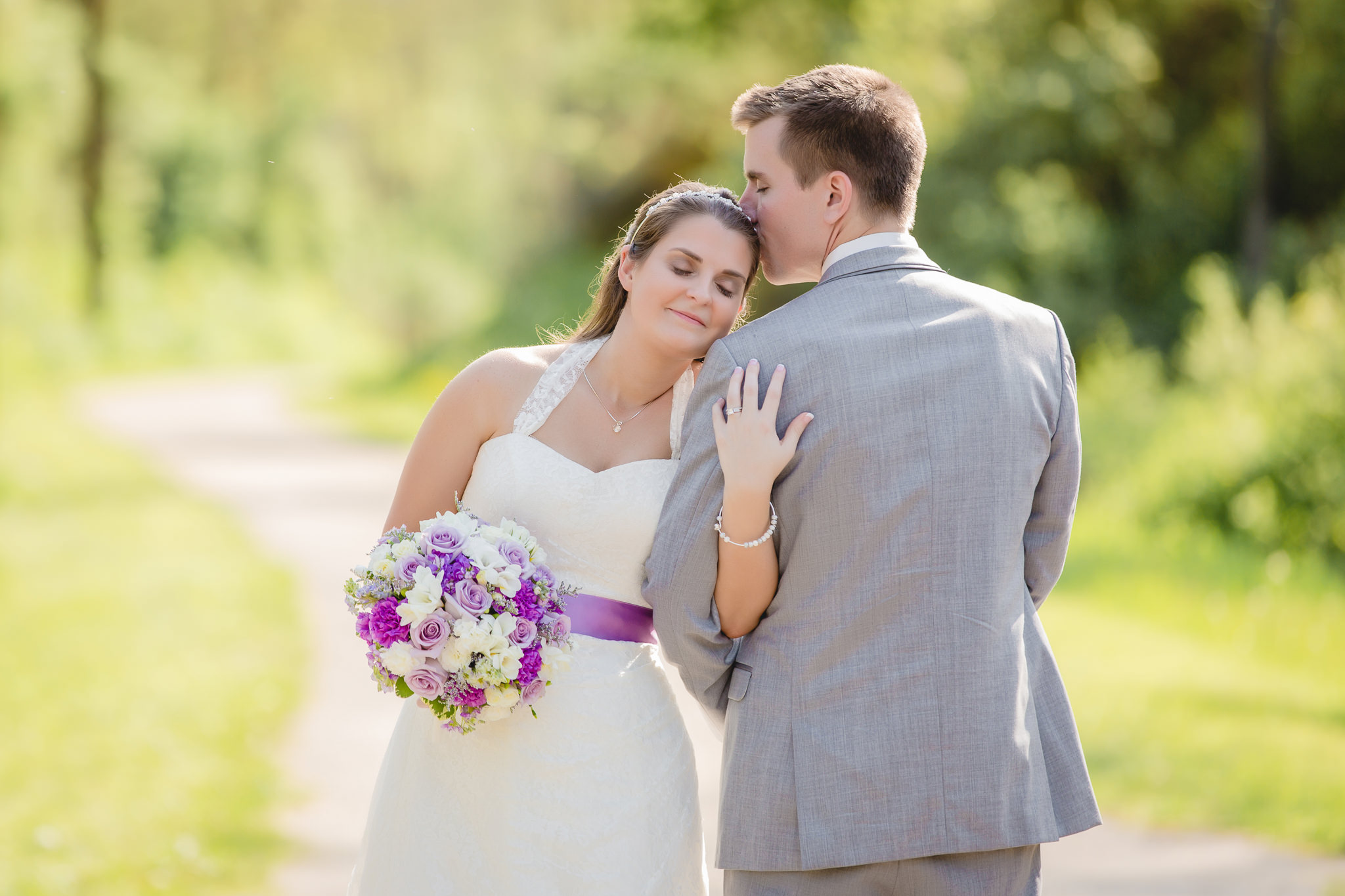 Groom kissing his bride before their Pittsburgh Airport Marriott wedding reception