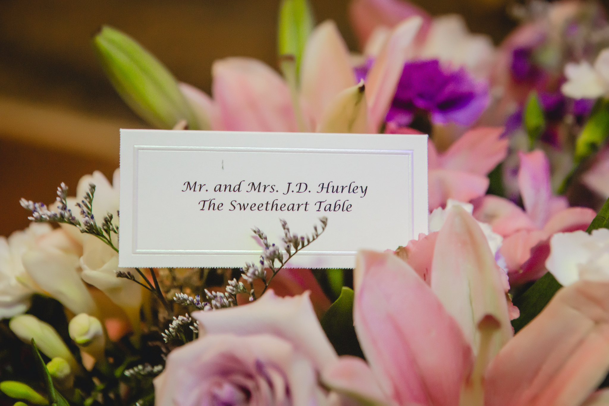 Bride and groom's place card in a bouquet by Carrie Anne Powell Floral Designs