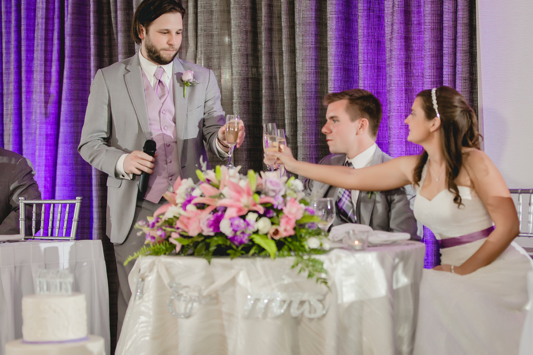 Best man toasts bride and groom at Pittsburgh Airport Marriott