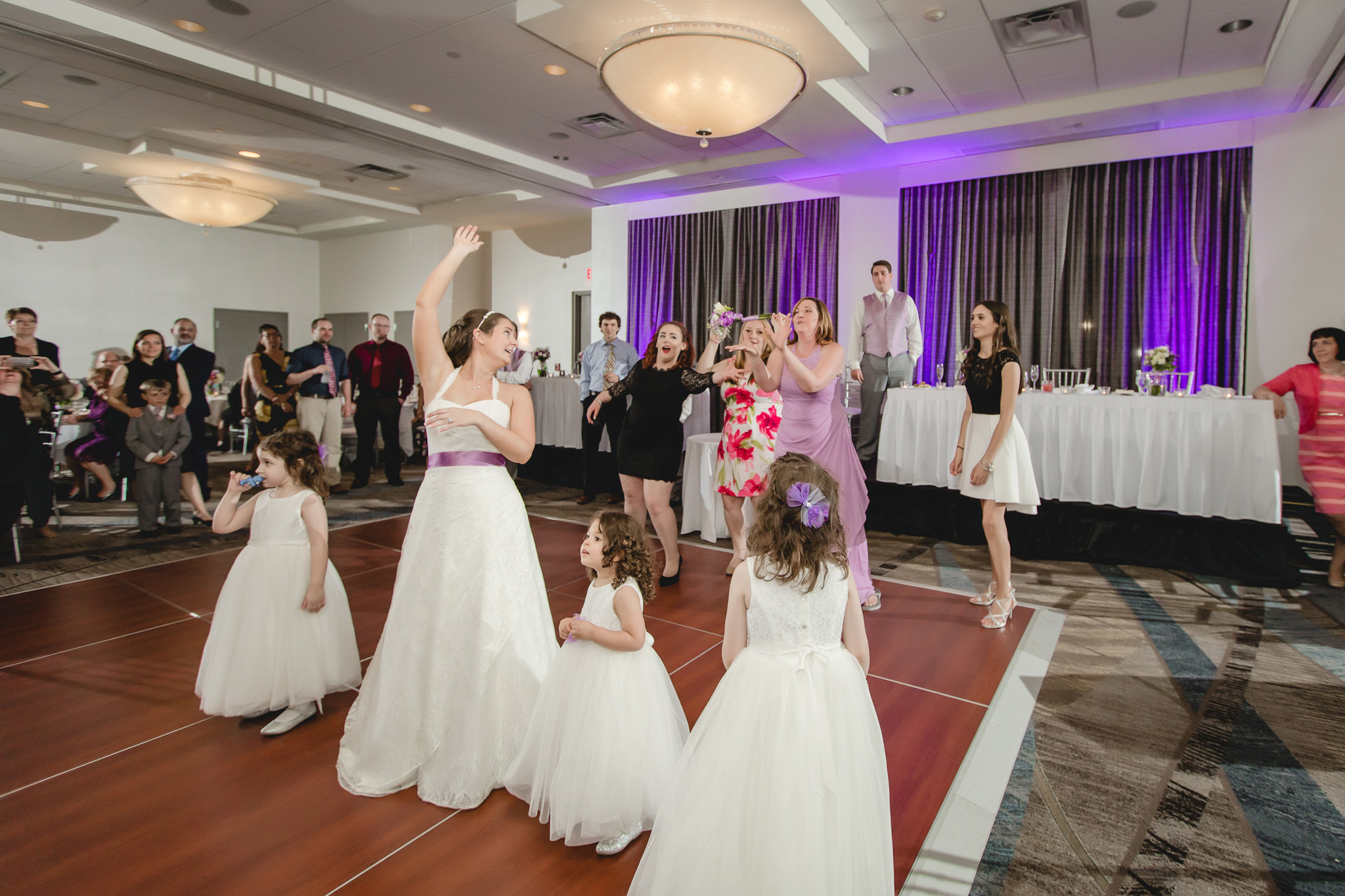 Bride tosses her bouquet at her Pittsburgh Airport Marriott reception