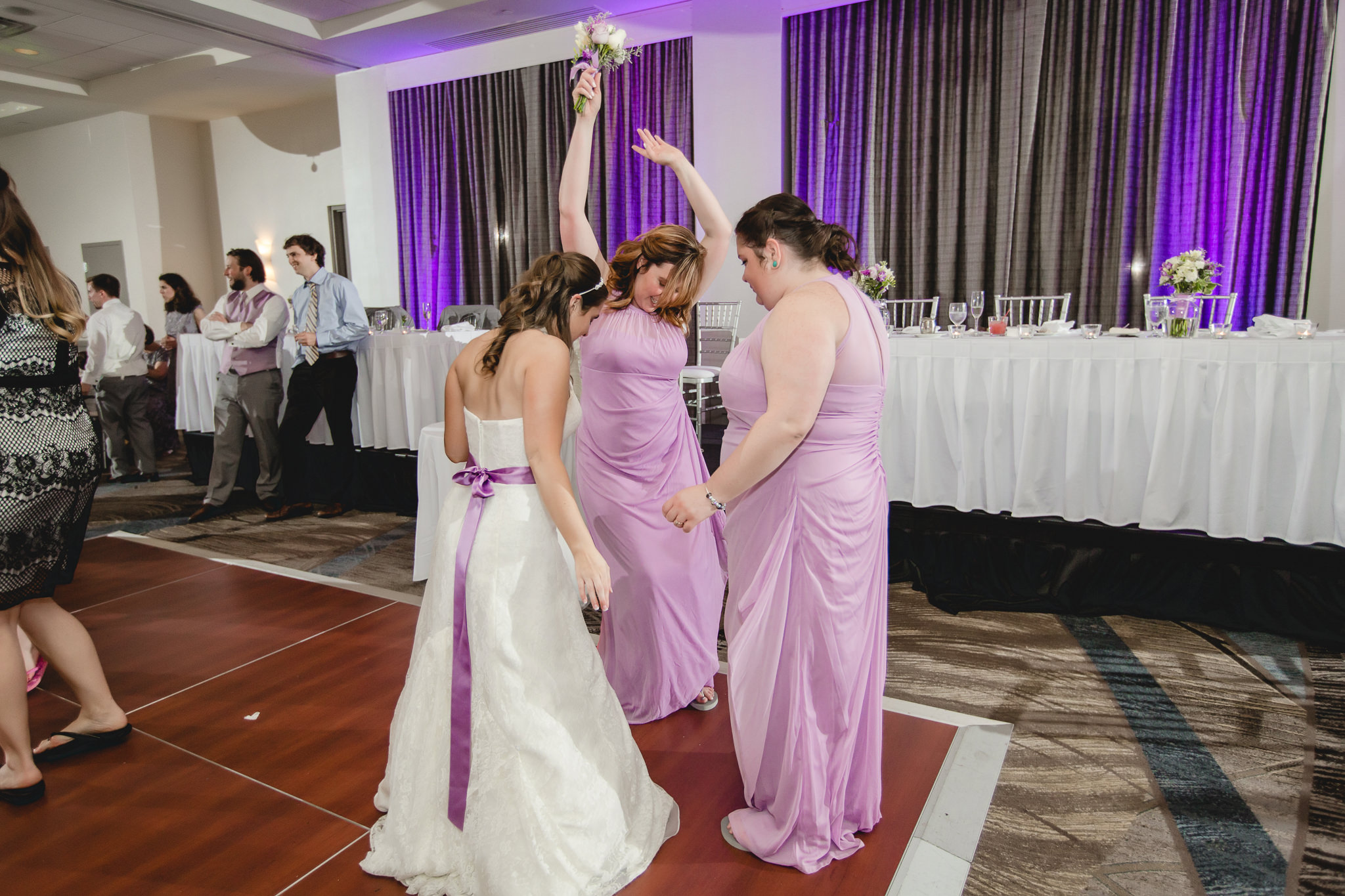 Bride and bridesmaids dancing at the Pittsburgh Airport Marriott