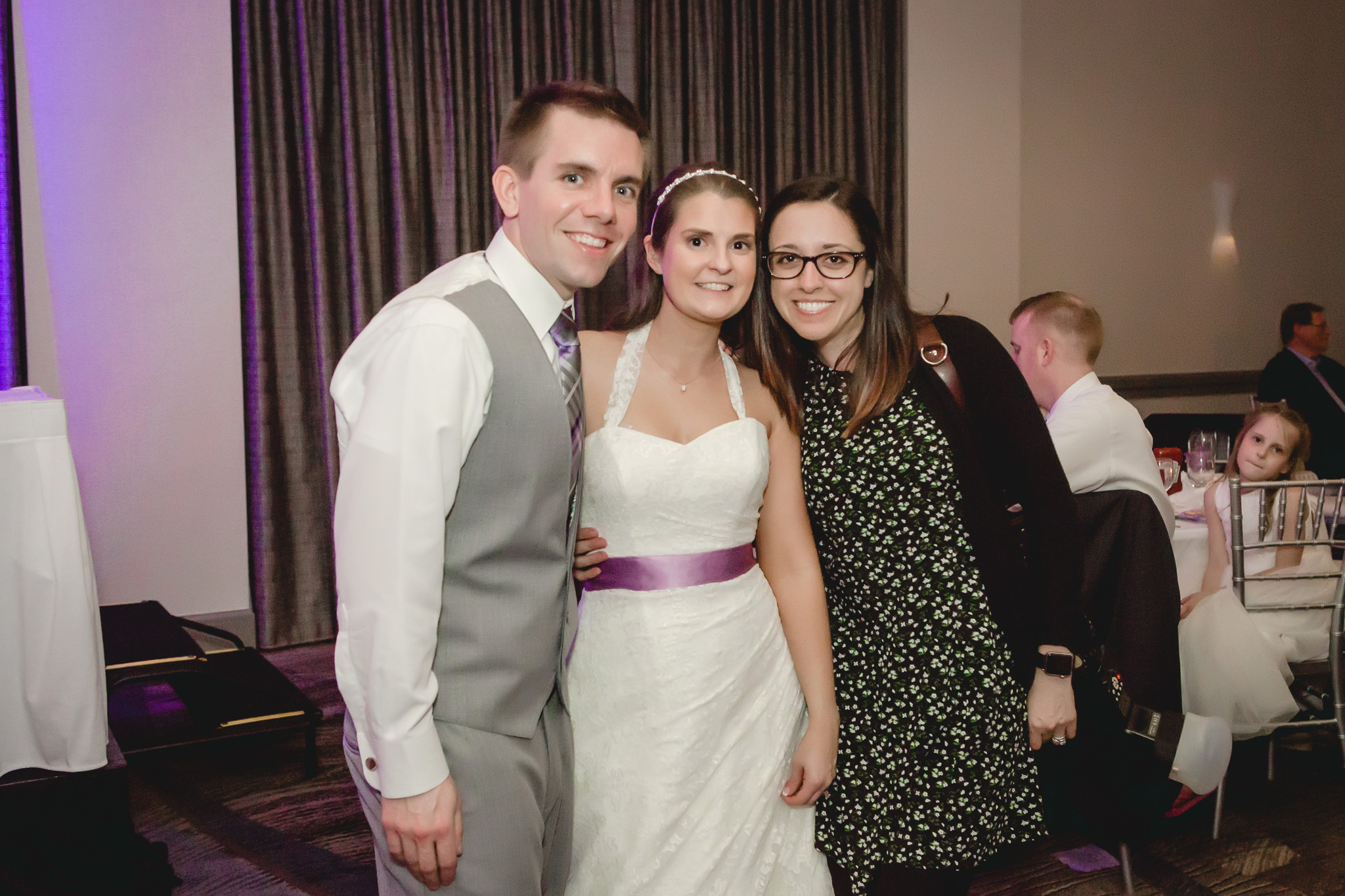 Bride and groom with their photographer at the Pittsburgh Airport Marriott