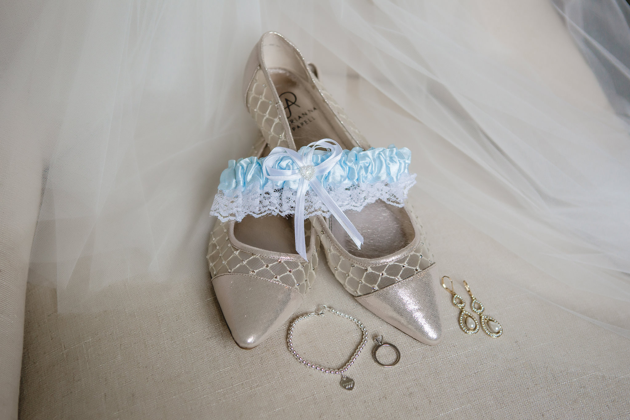 Bridal details including shoes and jewelry at Greystone Fields