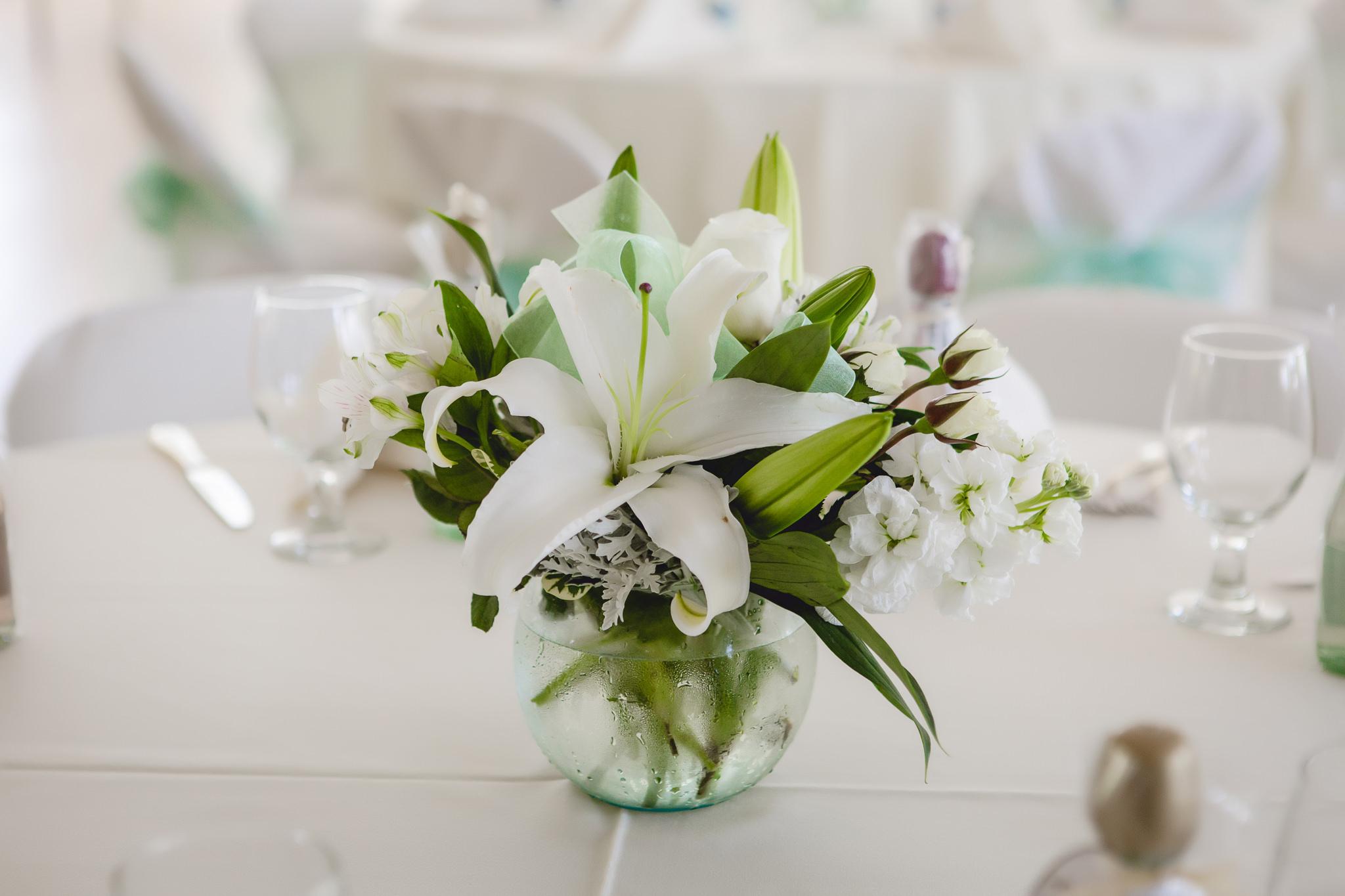 Floral centerpiece by Weischedel Florist at Greystone Fields