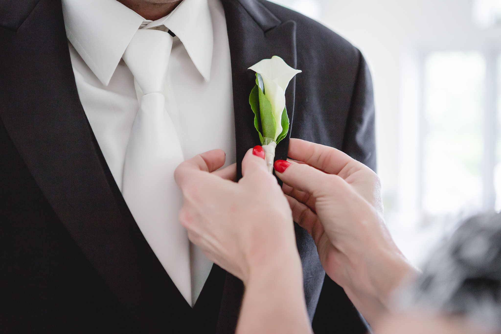 Groom's boutonniere by Weischedel Florist & Ghse