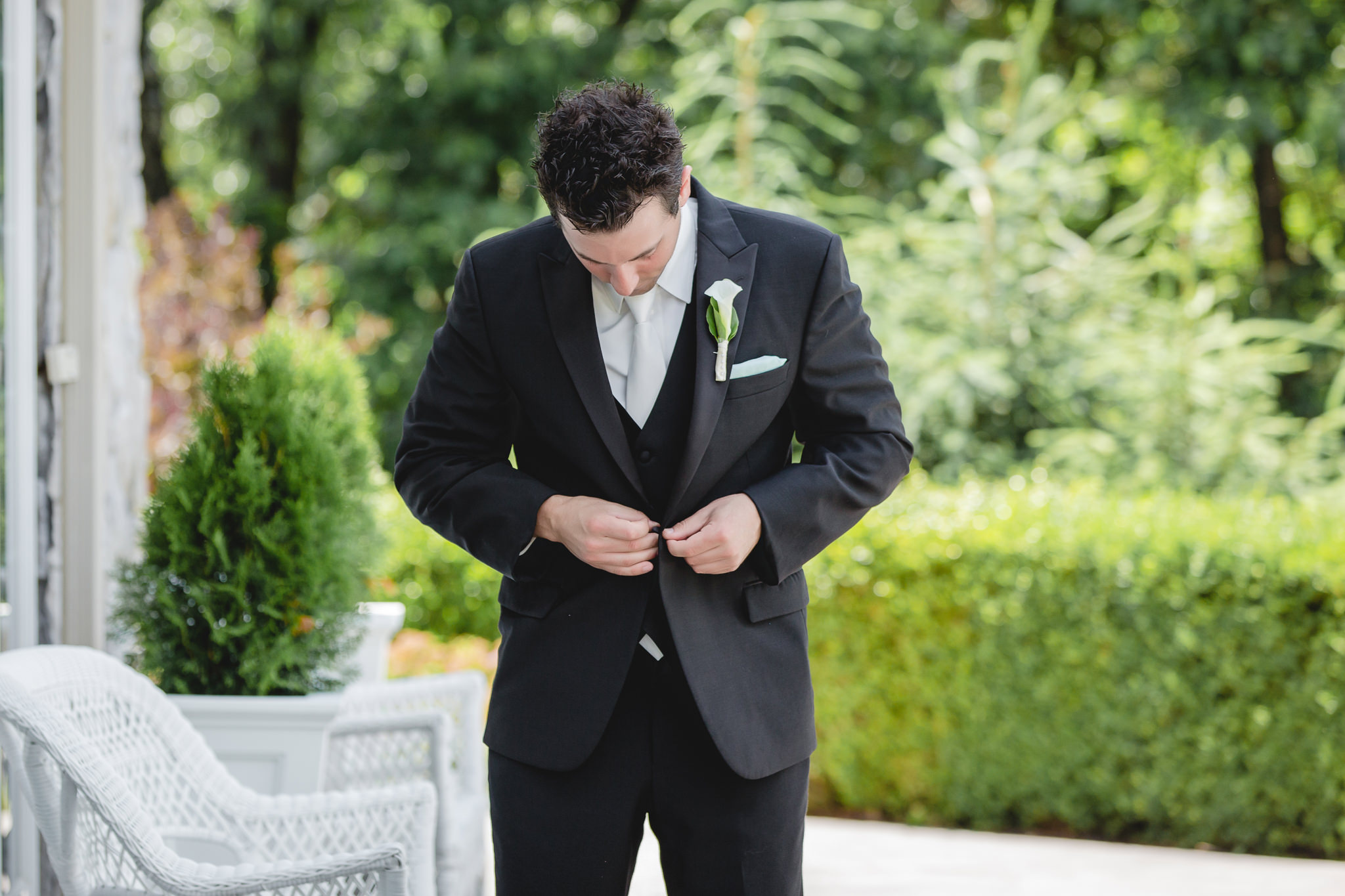 Groom getting ready for his wedding at Greystone Fields