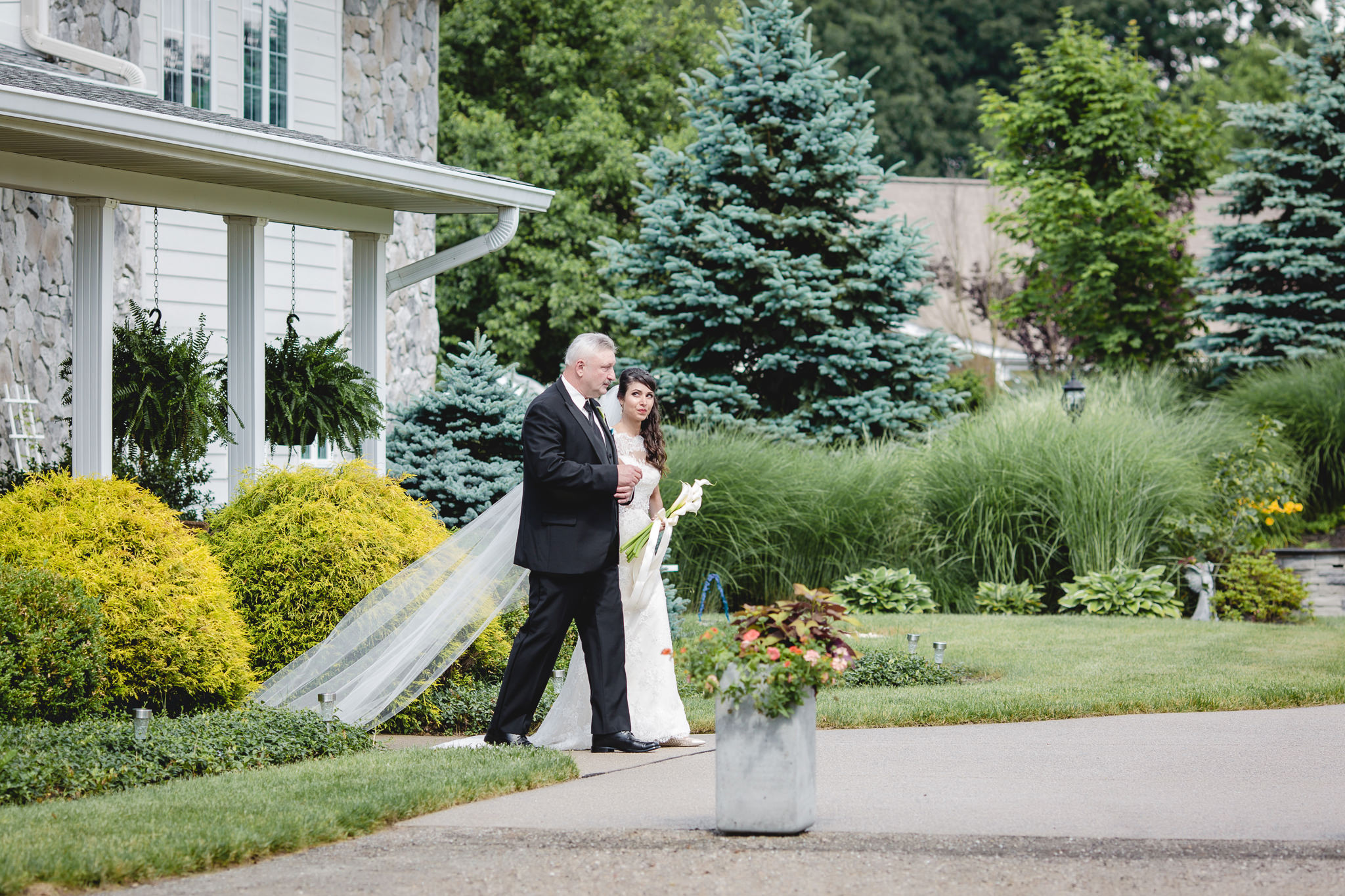 Father of the bride walks his daughter to her wedding ceremony at Greystone Fields