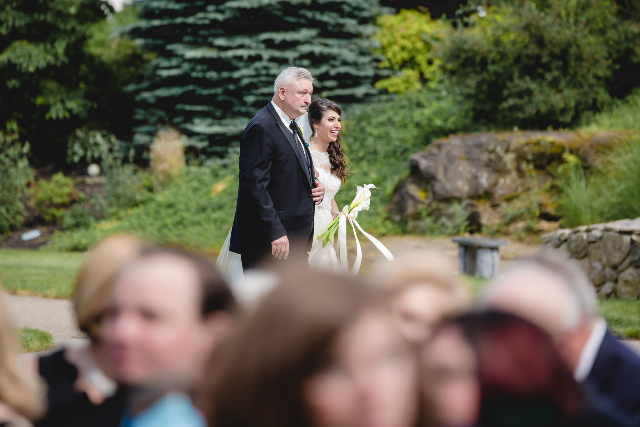 Bride walks to her wedding ceremony with her father