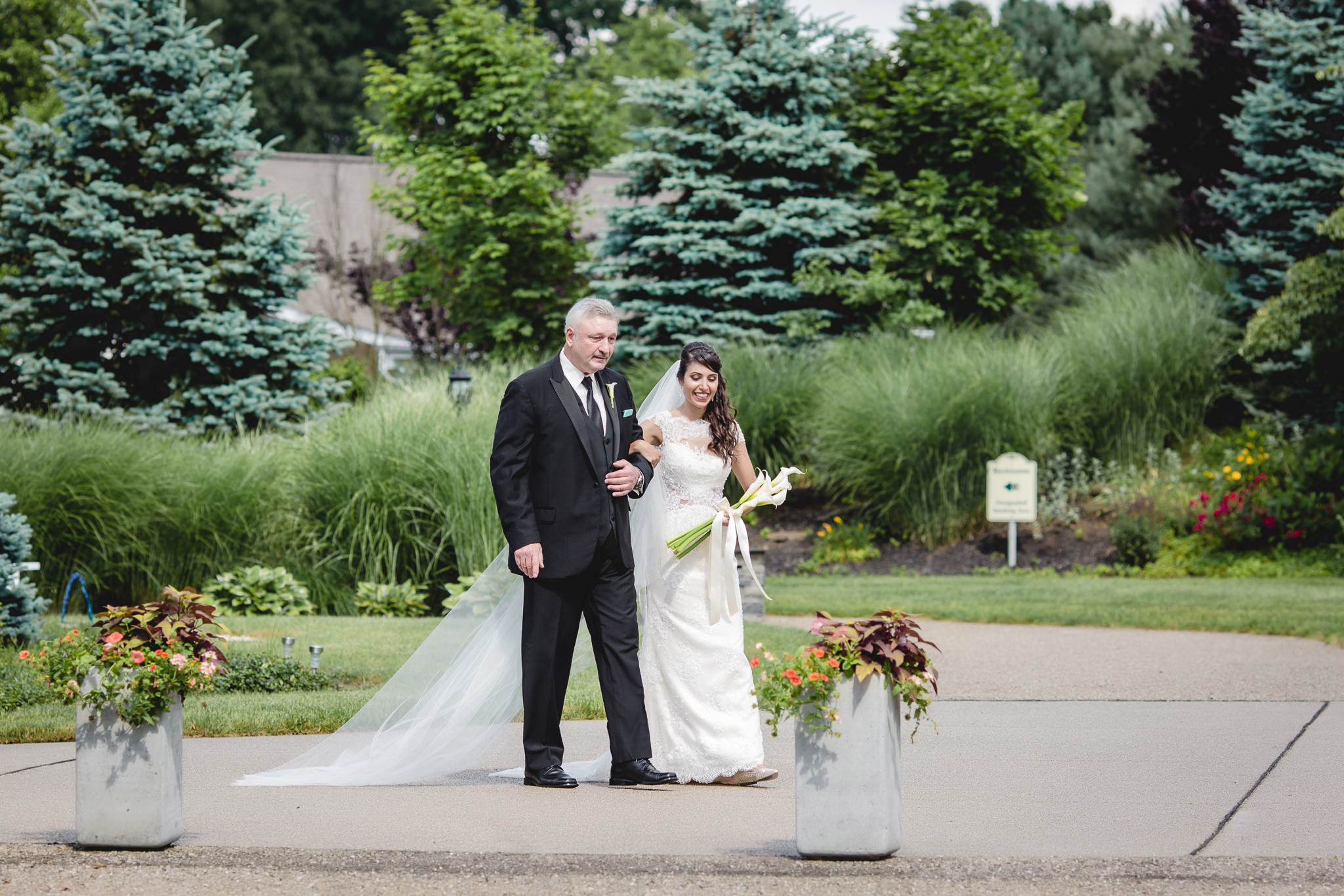 Father of the bride and his daughter at an outdoor wedding ceremony at Greystone Fields