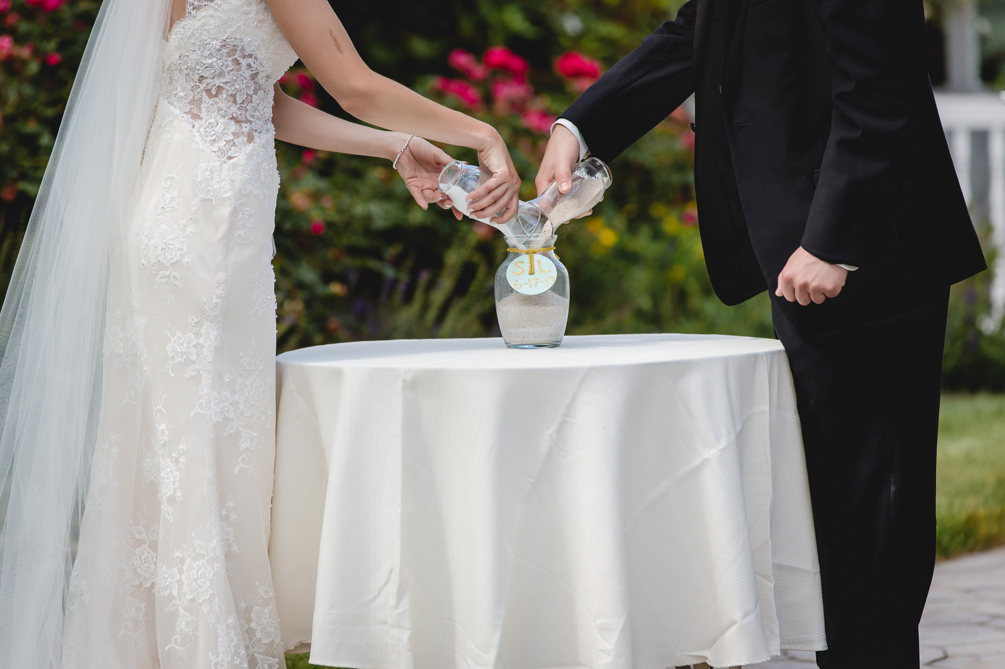Unity sand ceremony at an outdoor wedding at Greystone Fields
