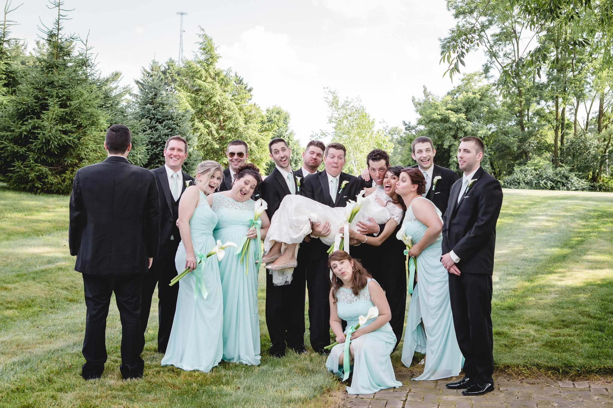 Bridal party poses for a goofy photo at Greystone Fields