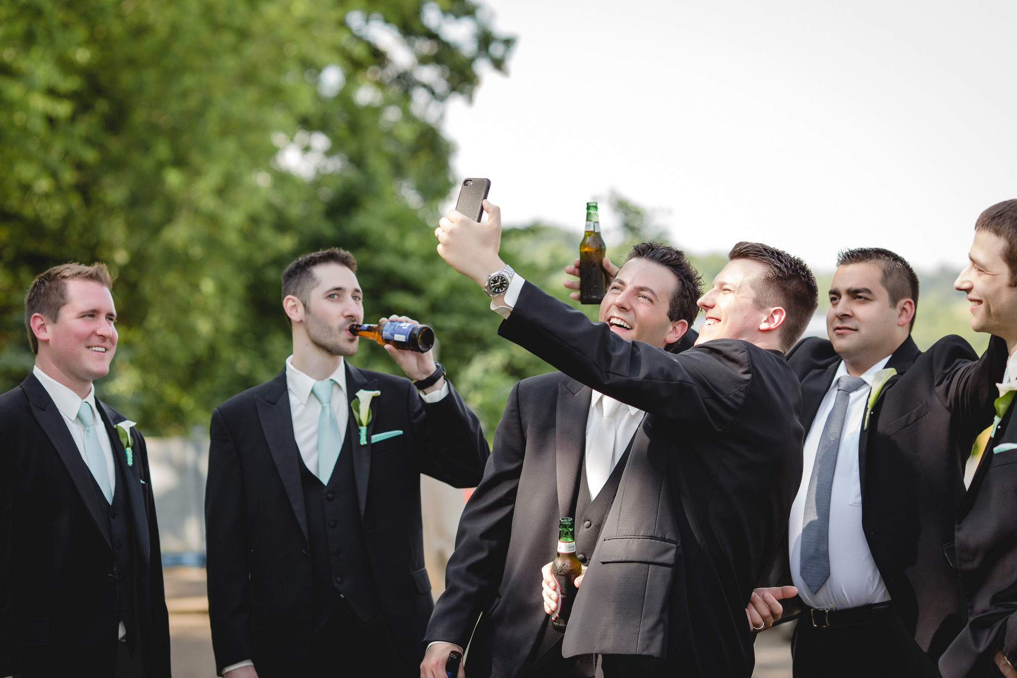 Groom takes a selfie with his groomsmen at Greystone Fields