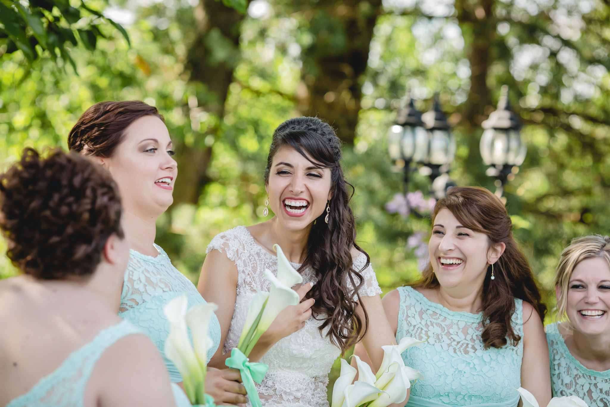 Bride laughing with her bridesmaids during portraits at Greystone Fields