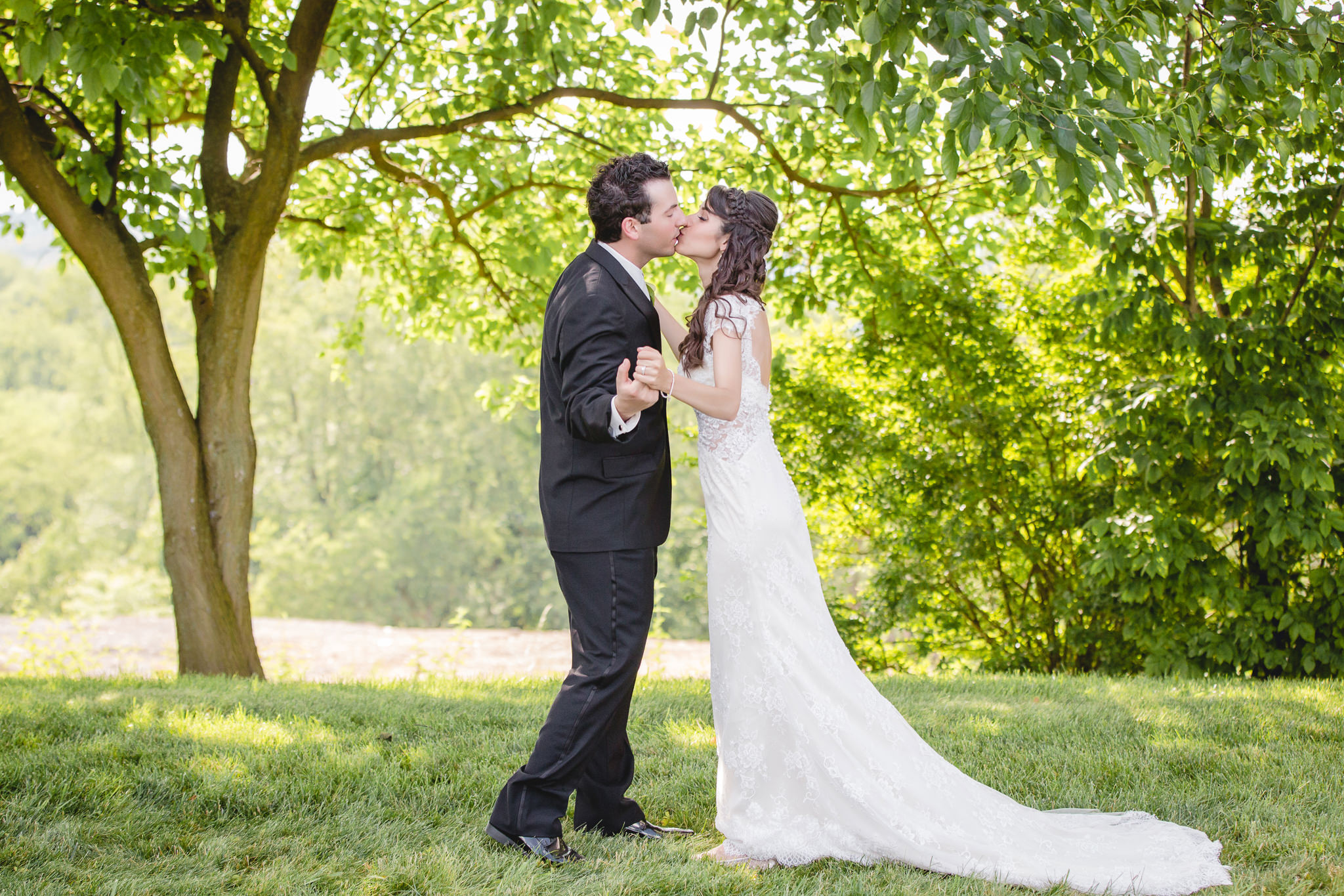 Bride and groom kiss during portraits at Greystone Fields