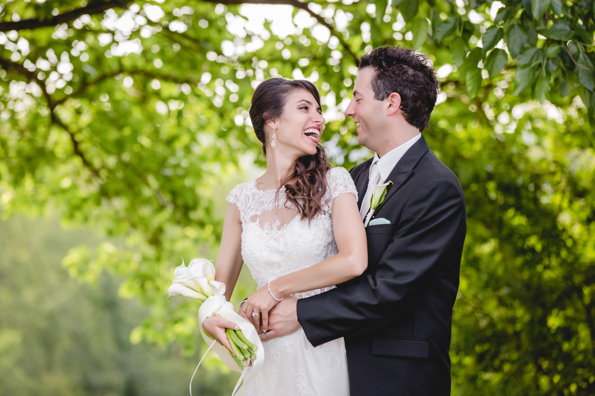 Bride laughs with her groom during photos at Greystone Fields