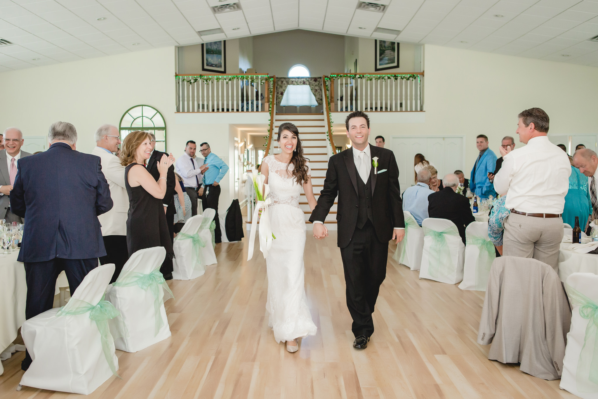 Newlyweds enter their wedding reception at Greystone Fields
