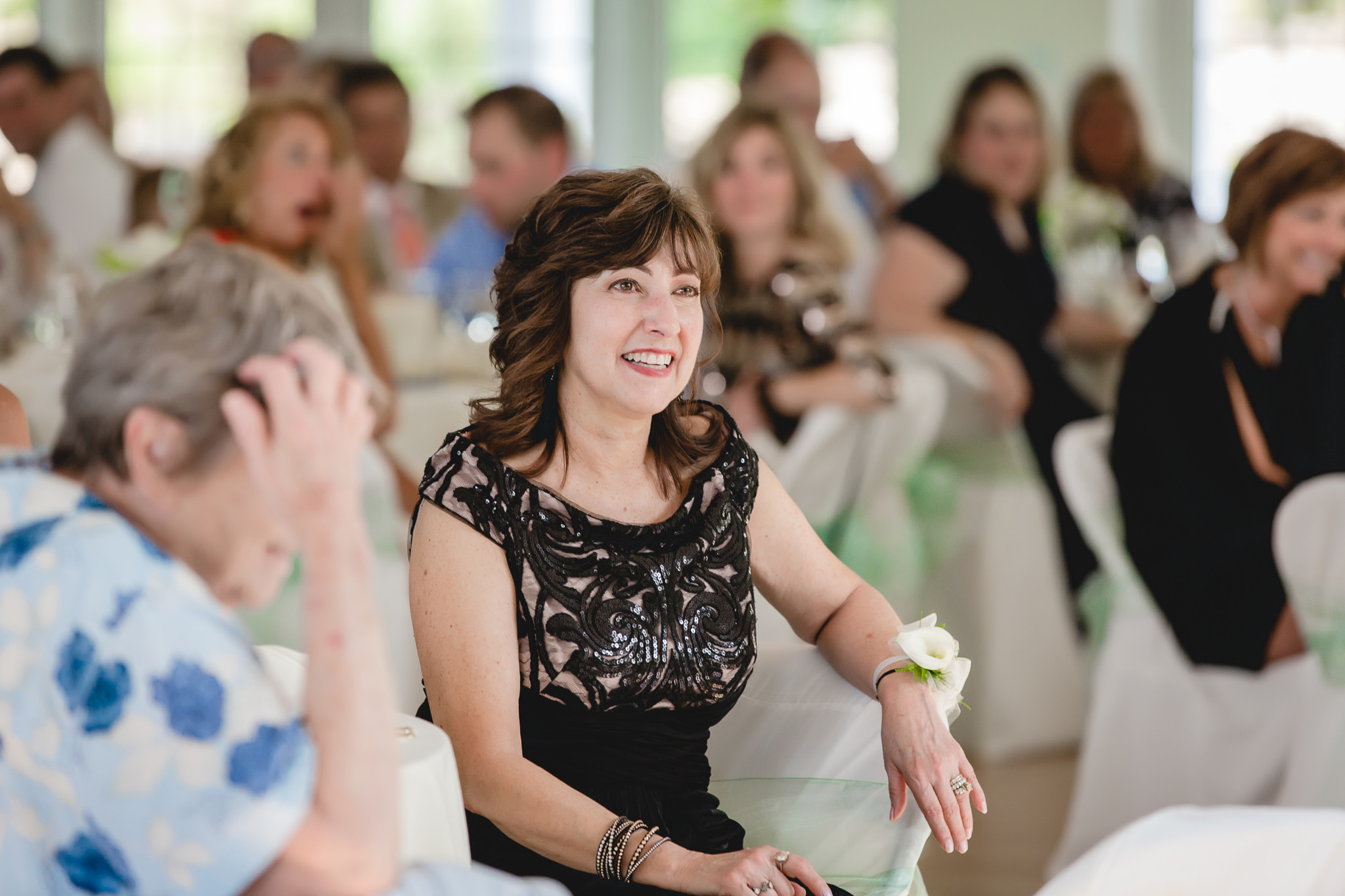 Mother of the bride laughs during speeches at Greystone Fields