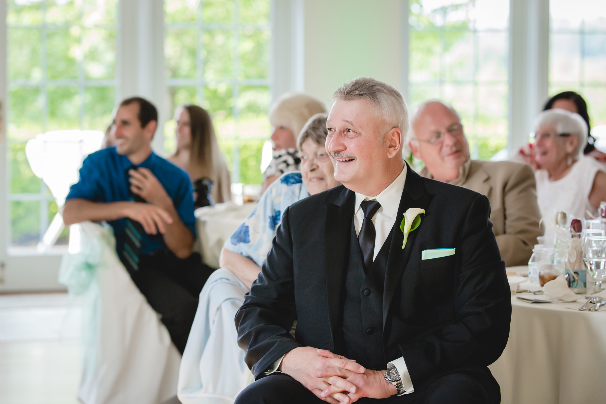 Father of the bride laughs during speeches at Greystone Fields