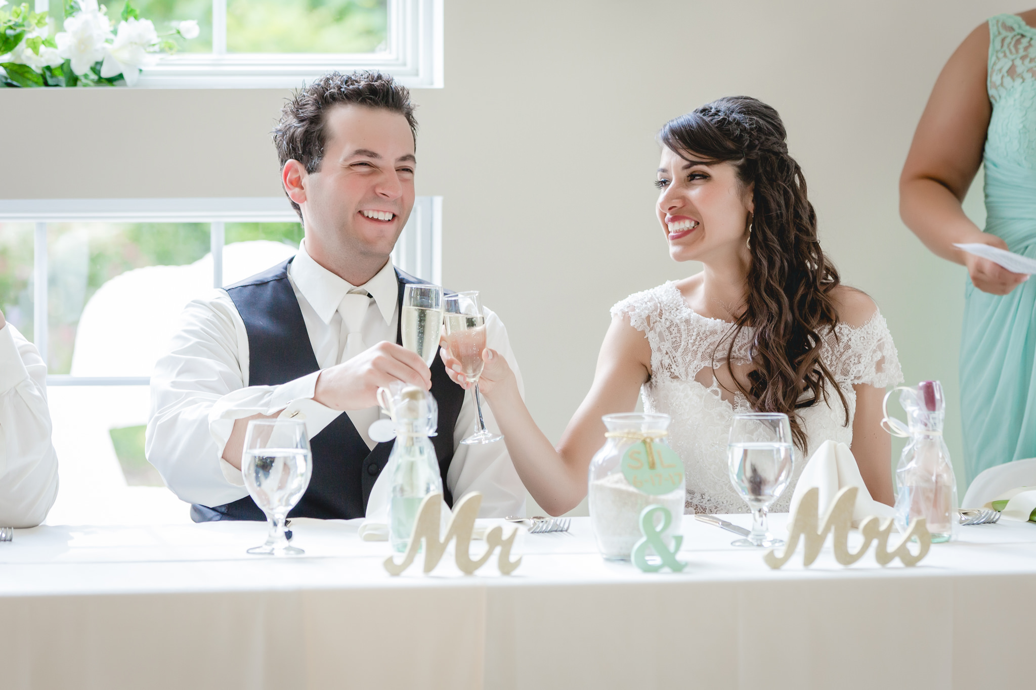 Bride and groom toasting each other at their wedding reception