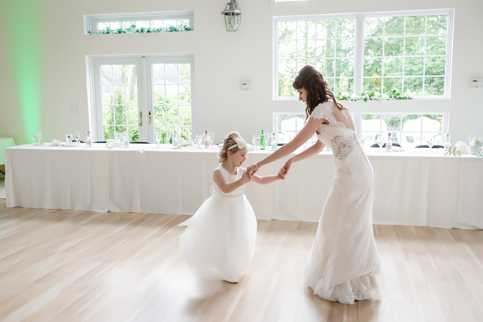 Bride dances with the flower girl at her Greystone Fields reception
