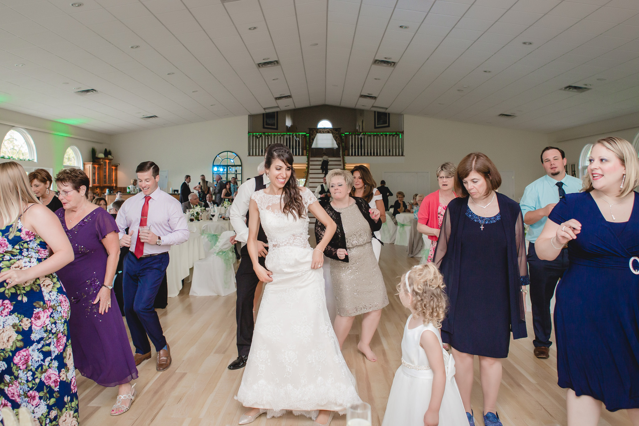 Bride dances with her guests at a Greystone Fields wedding reception