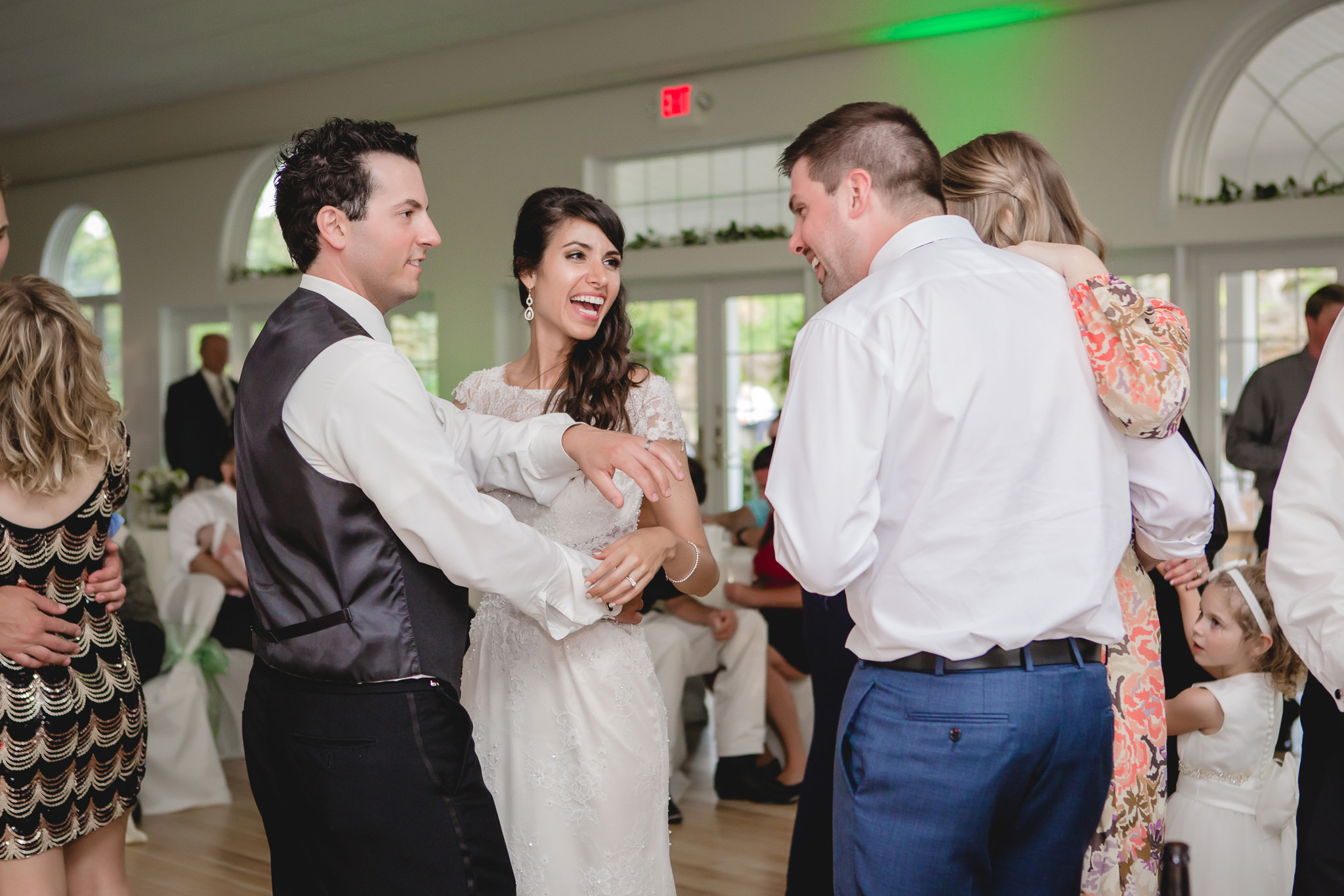 Groom shows off his ring to friends at his wedding reception in Gibsonia, PA