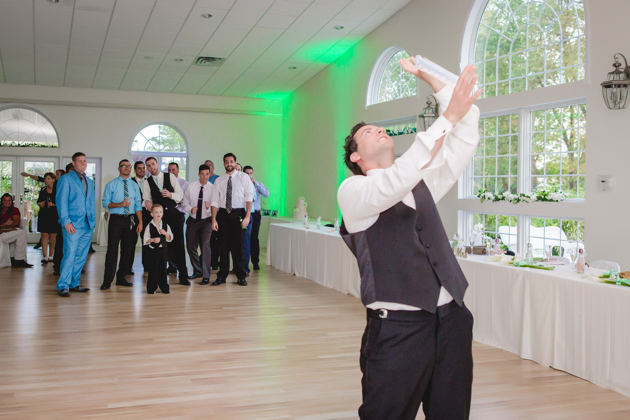Groom tosses the garter to the single men at Greystone Fields