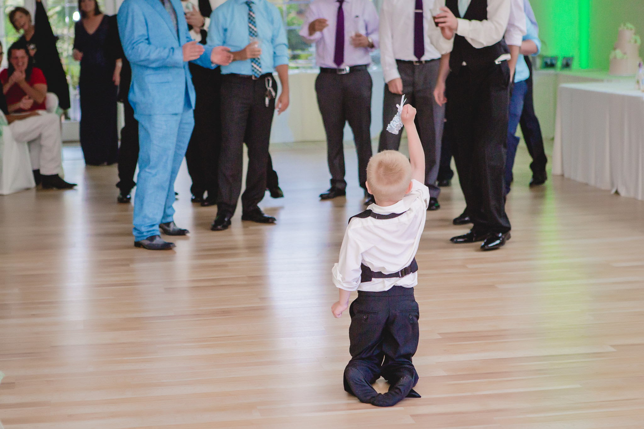 Ring bearer catches the garter at a wedding reception