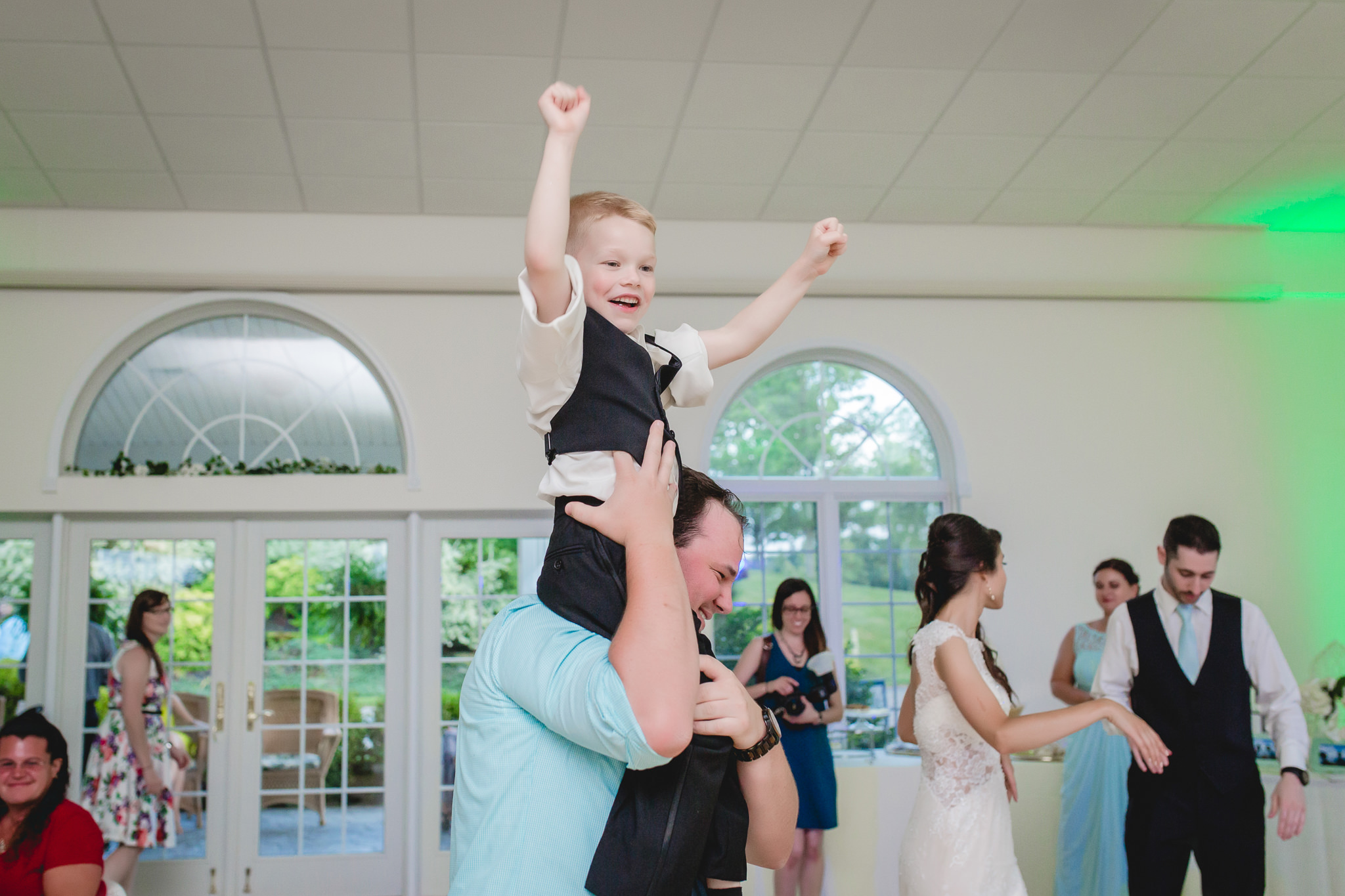 Ring bearer celebrates on the dance floor at Greystone Fields