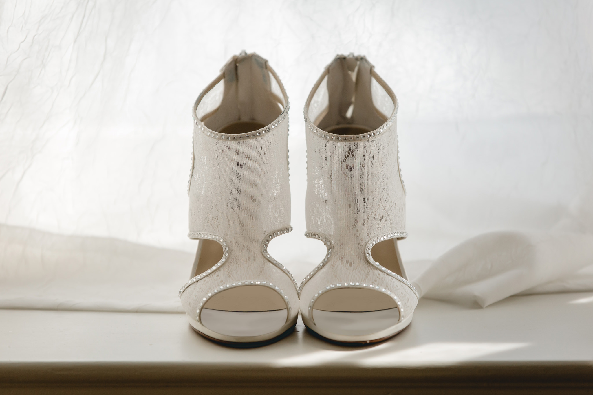 Bride's wedding shoes on a window sill at Linden Hall