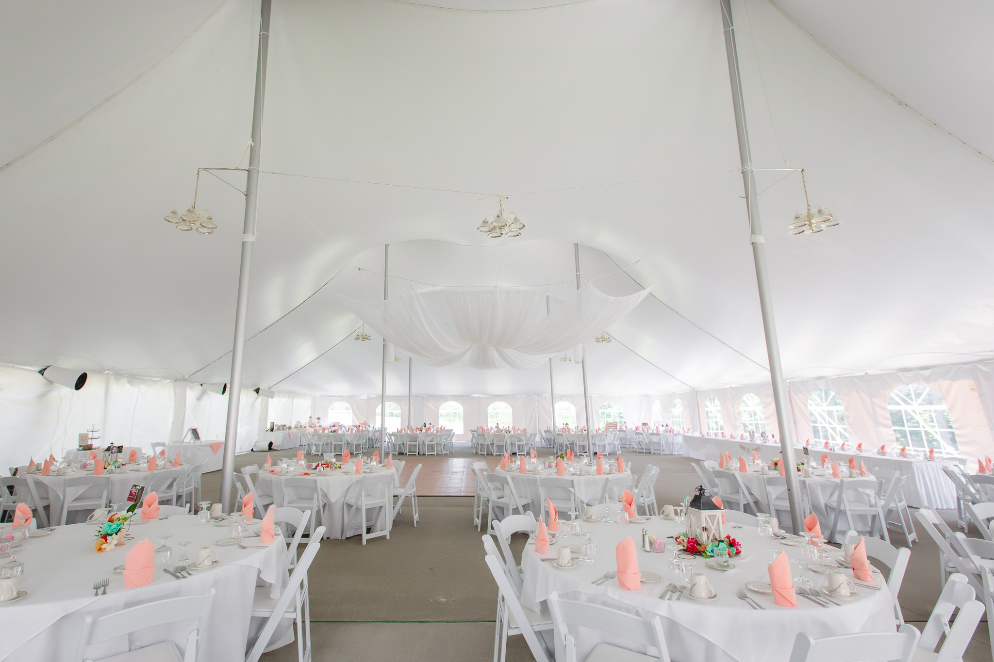 Reception tent at Linden Hall decorated for a wedding reception
