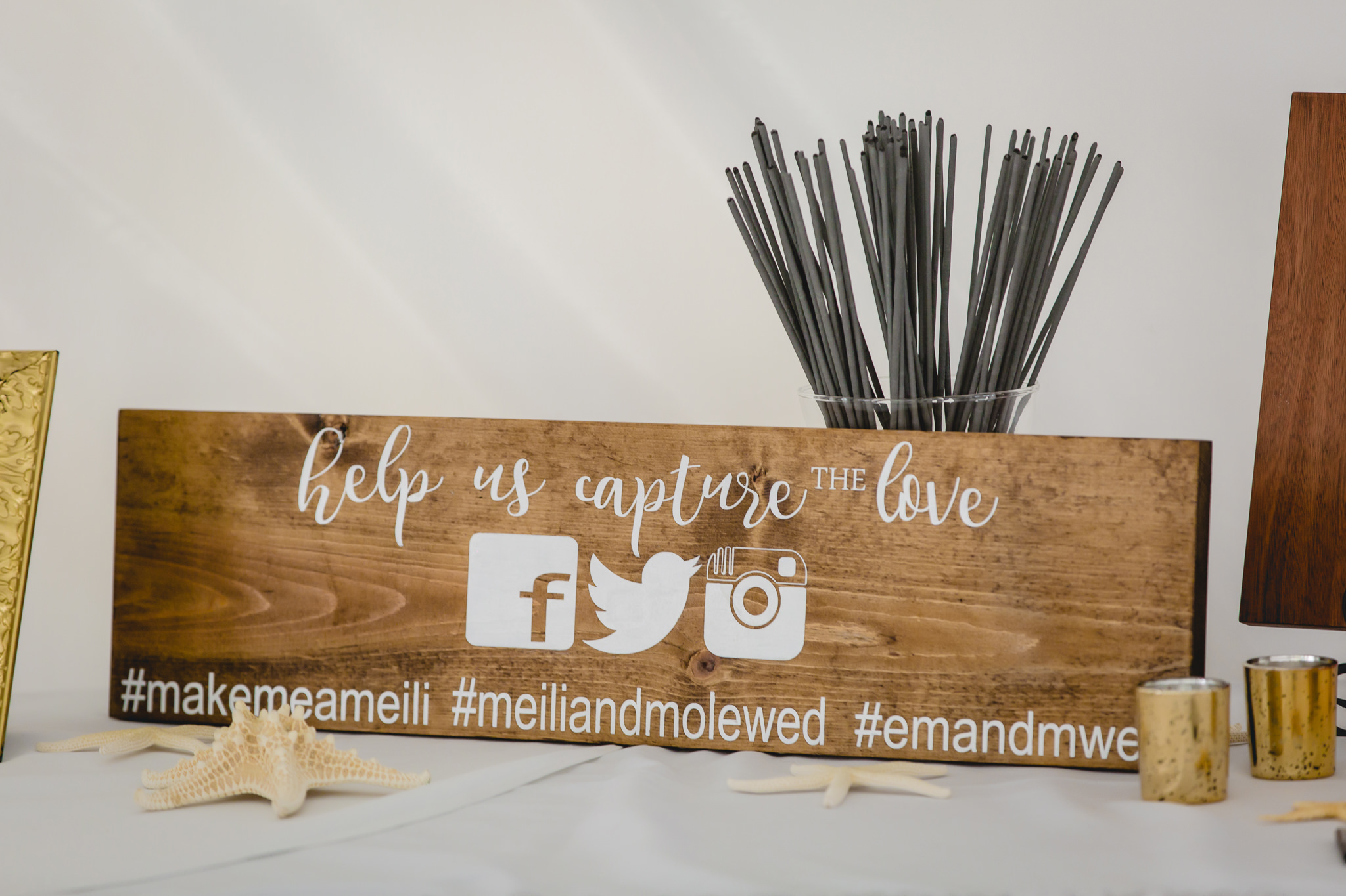Social media sign containing wedding day hashtags for Facebook, Twitter, & Instagram