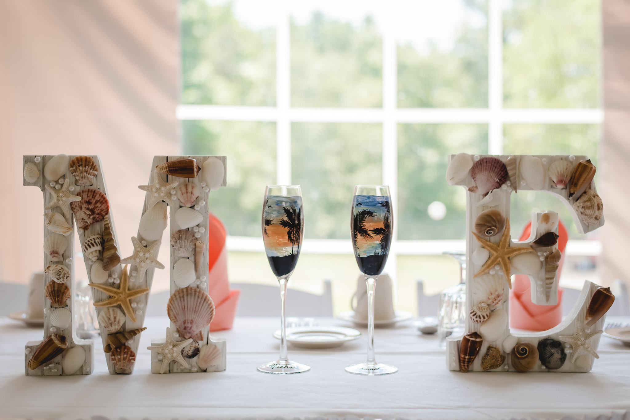 Beach-themed monograms and toasting flutes at a Linden Hall wedding reception