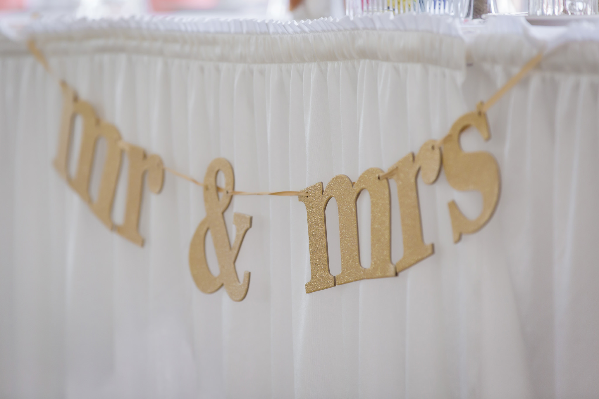 Mr & Mrs sign hanging on the head table at Linden Hall