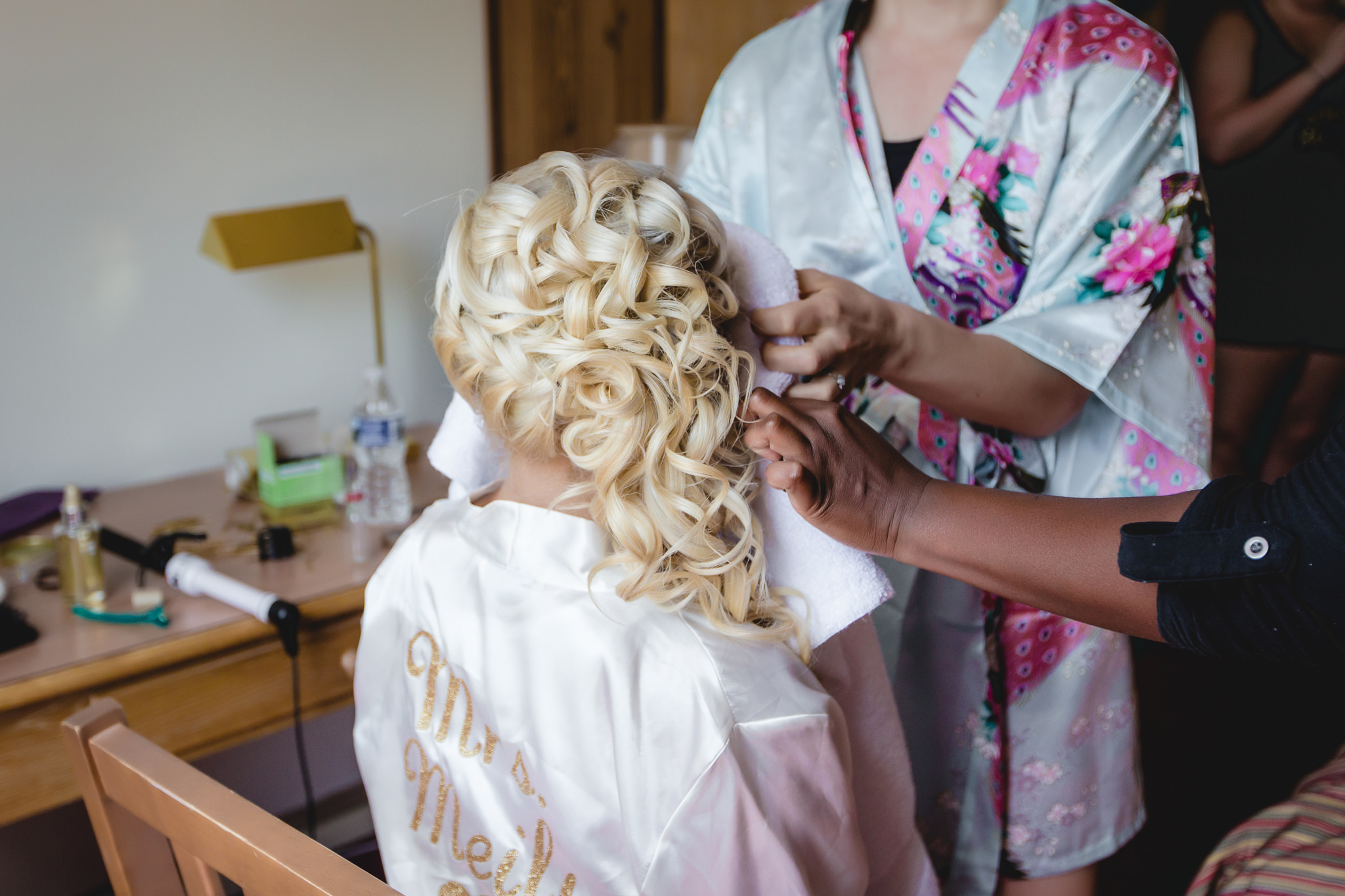 Bride getting her hair and makeup done at the Linden Hall lodge