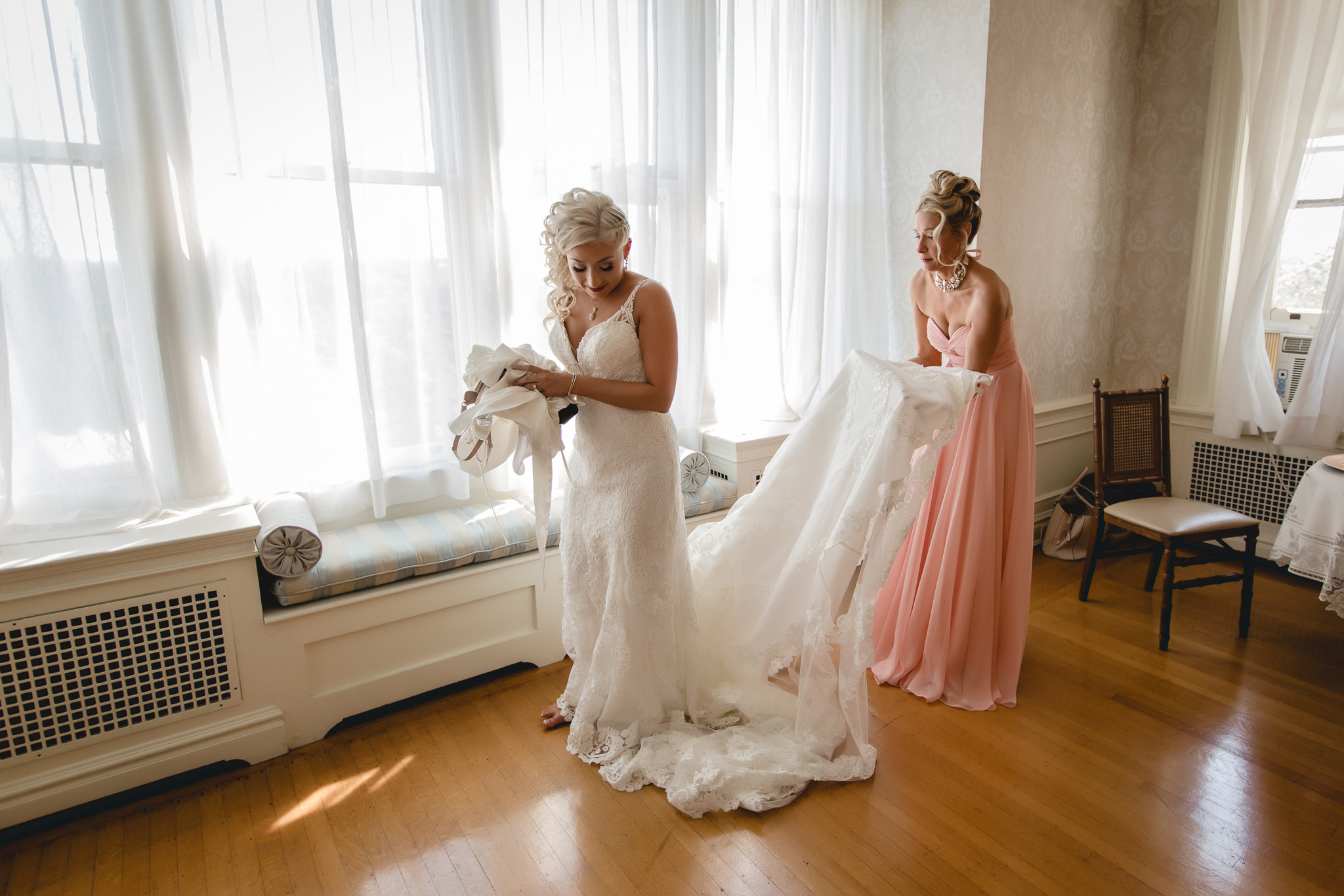 Bride's mother fluffs her train at Linden Hall mansion