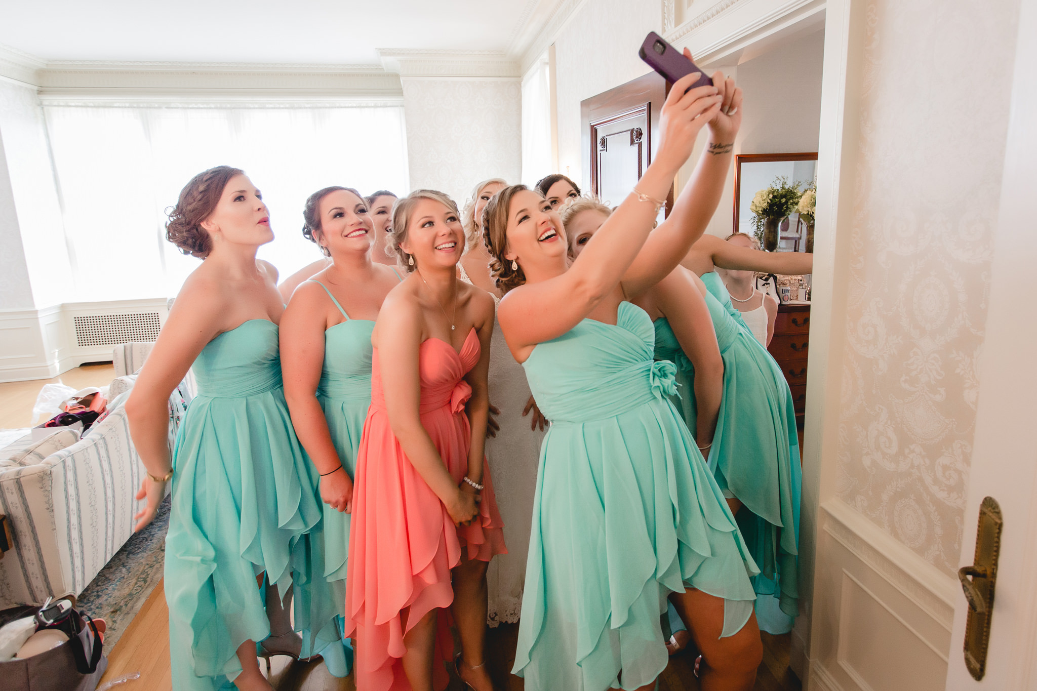 Bridesmaids take a selfie before heading to the wedding ceremony