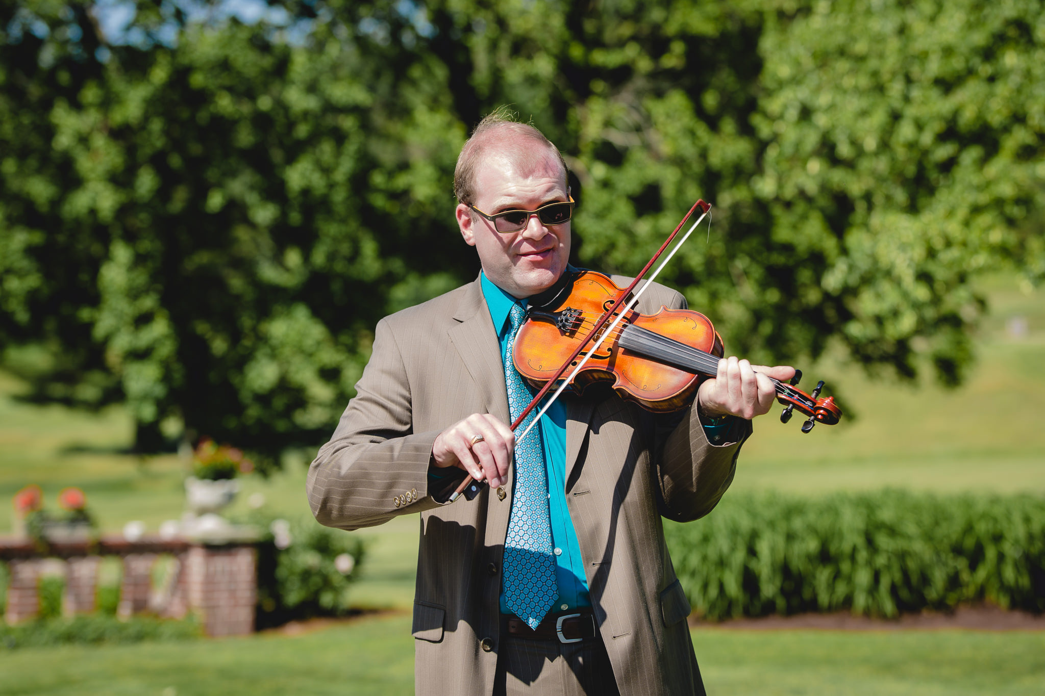 Violinist plays music during a wedding ceremony at Linden Hall
