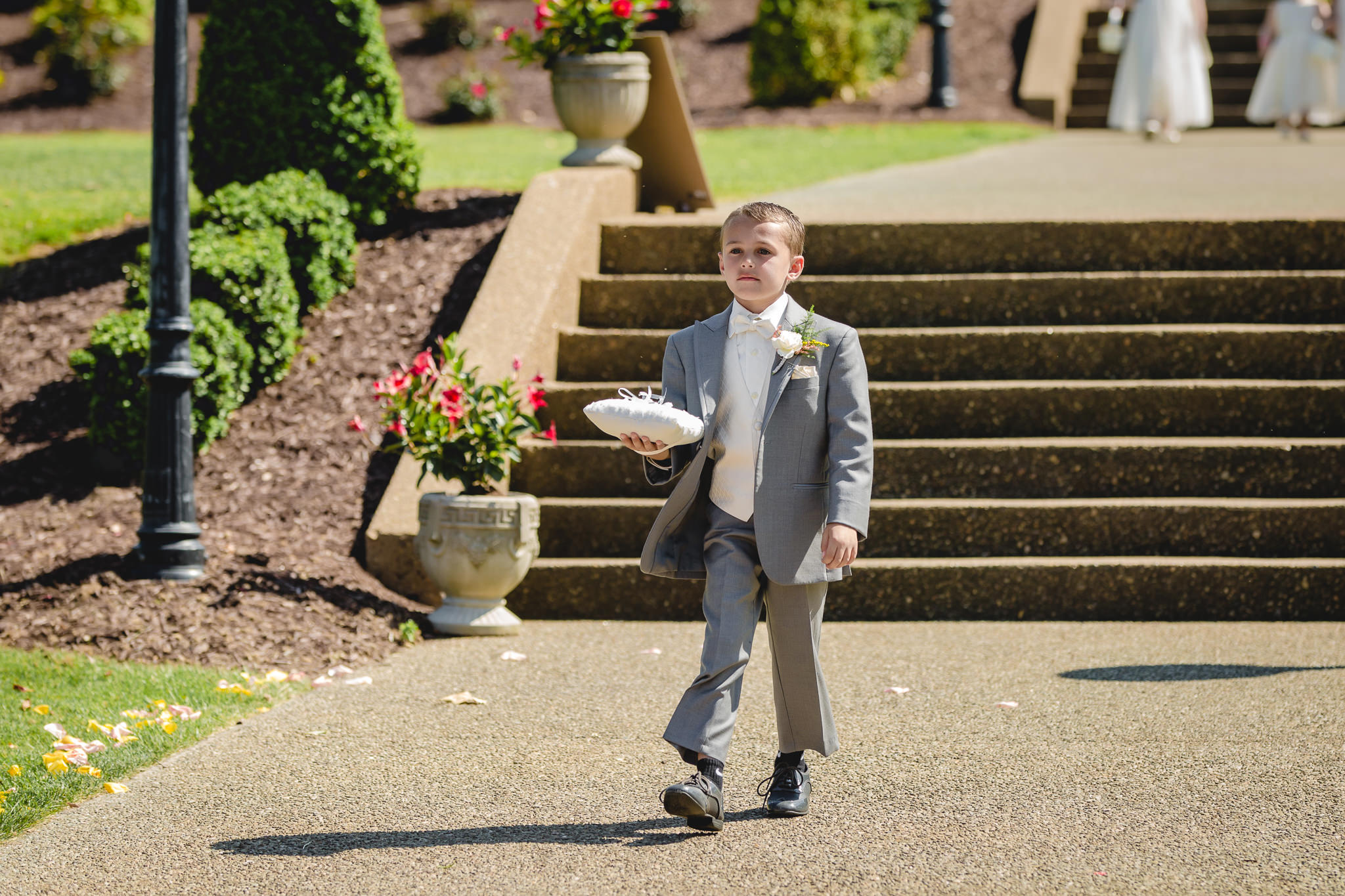 Ring bearer walks down the aisle at Linden Hall